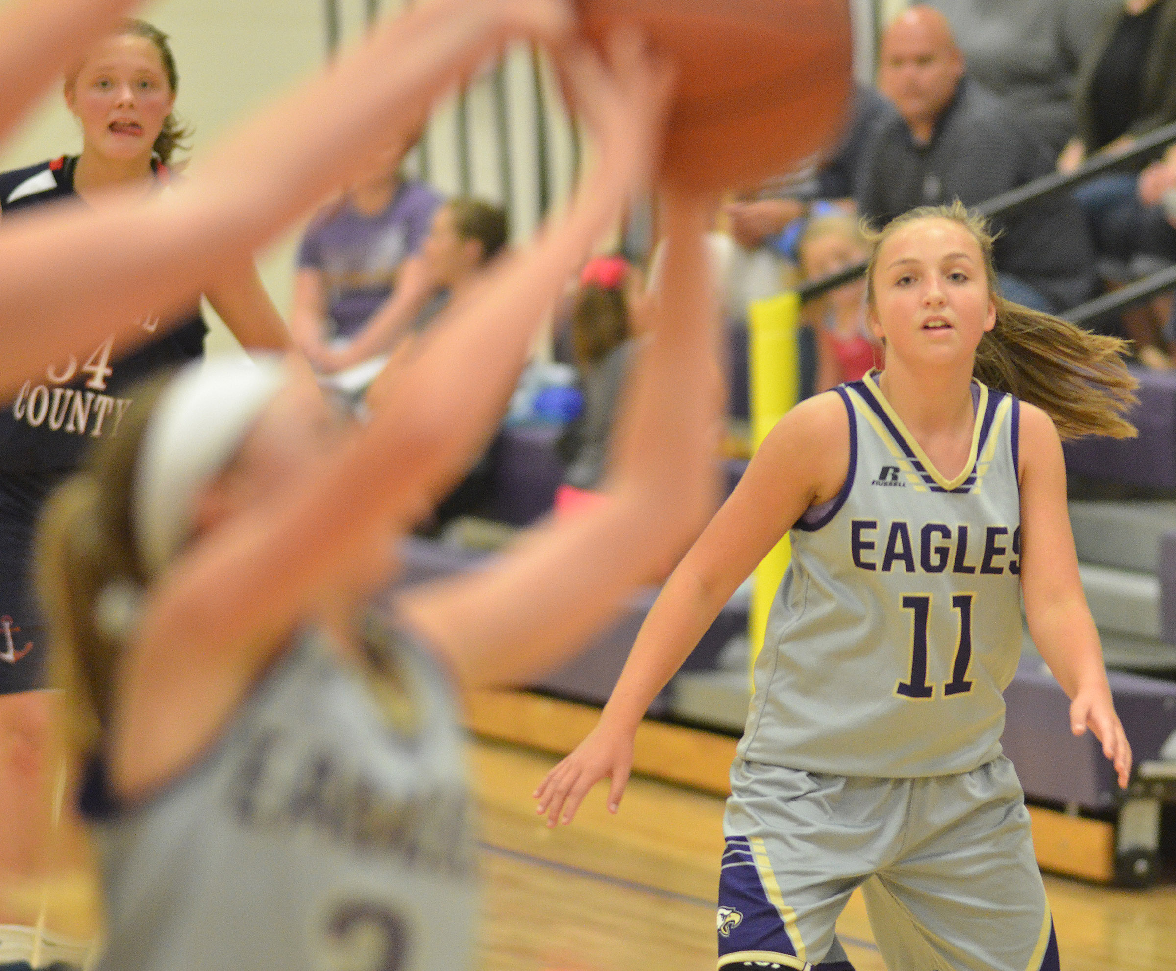 CMS eighth-grader Lainey Watson looks for a rebound.