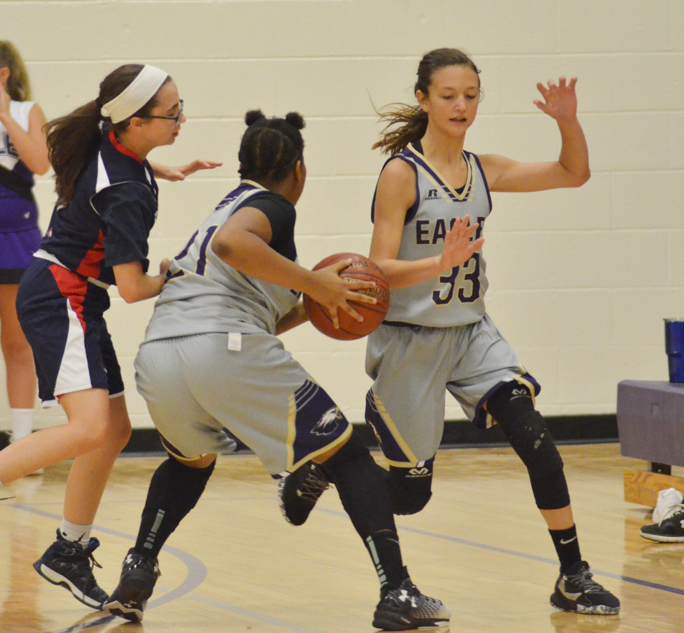 CMS seventh-grader Antaya Epps dribbles to the basket as classmates Bri Hayes plays defense.