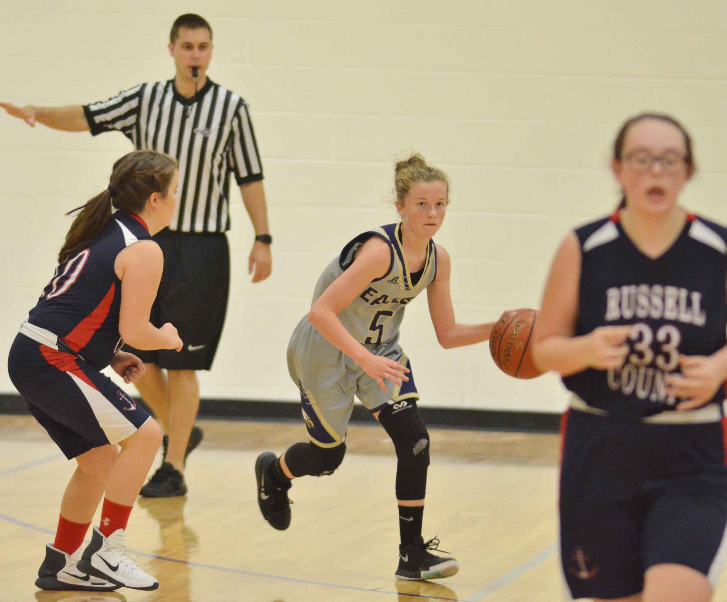 CMS seventh-grader Dakota Slone dribbles down the court.
