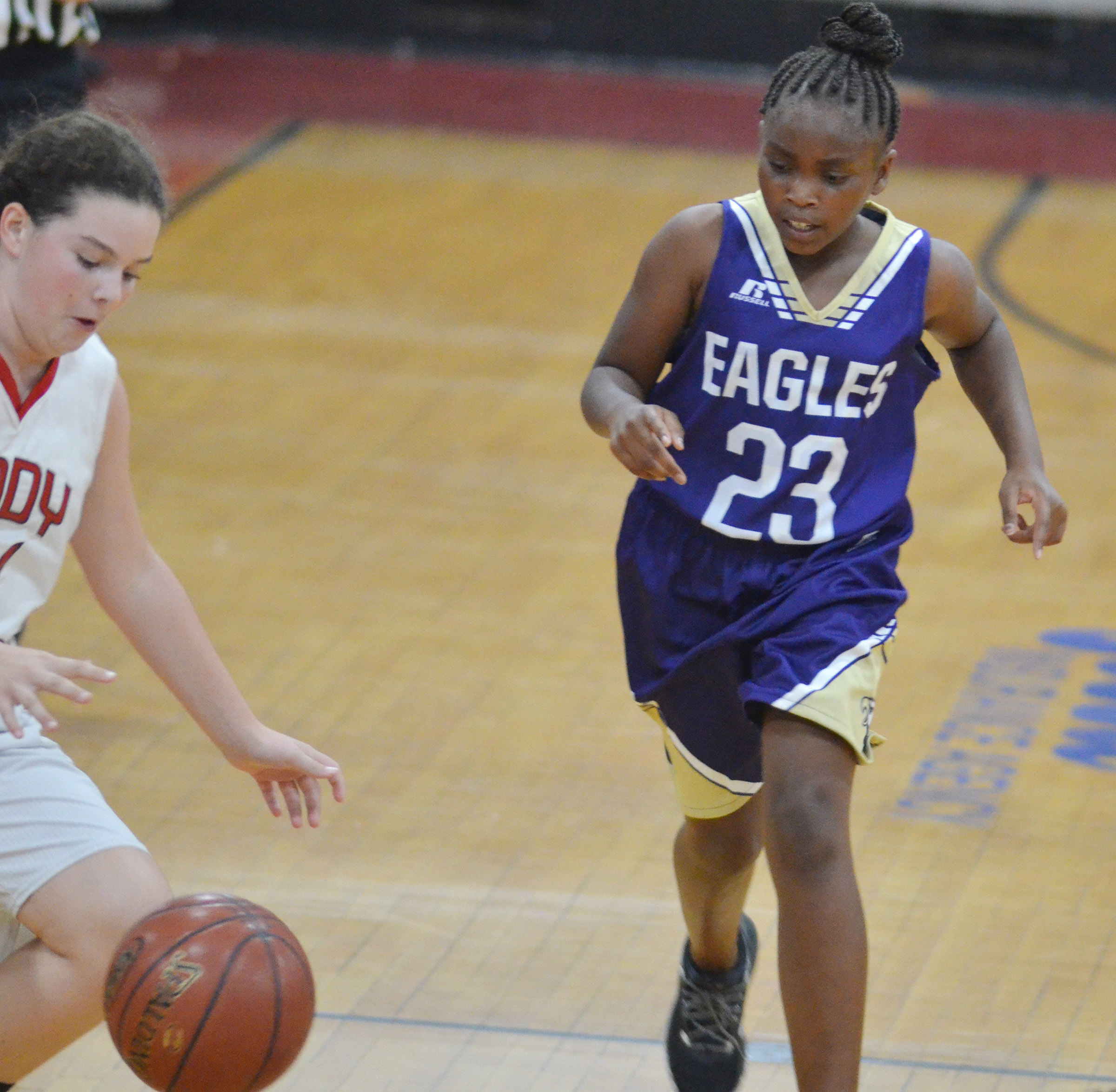Campbellsville Elementary School fifth-grader Ta'Zaria Owens looks to steal the ball.