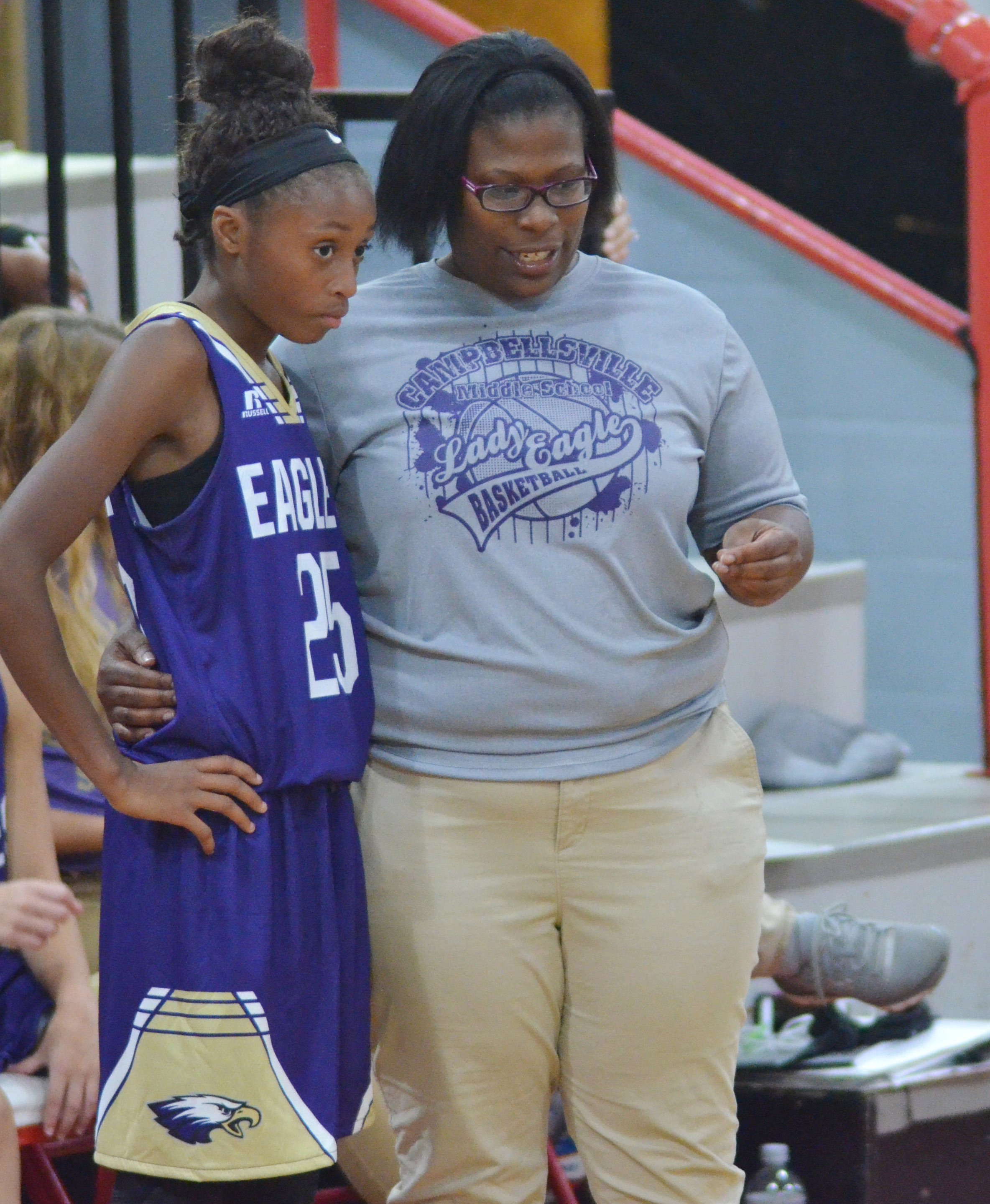 CMS girls' basketball head coach Tiarra Cecil talks with eighth-grader Bri Gowdy.