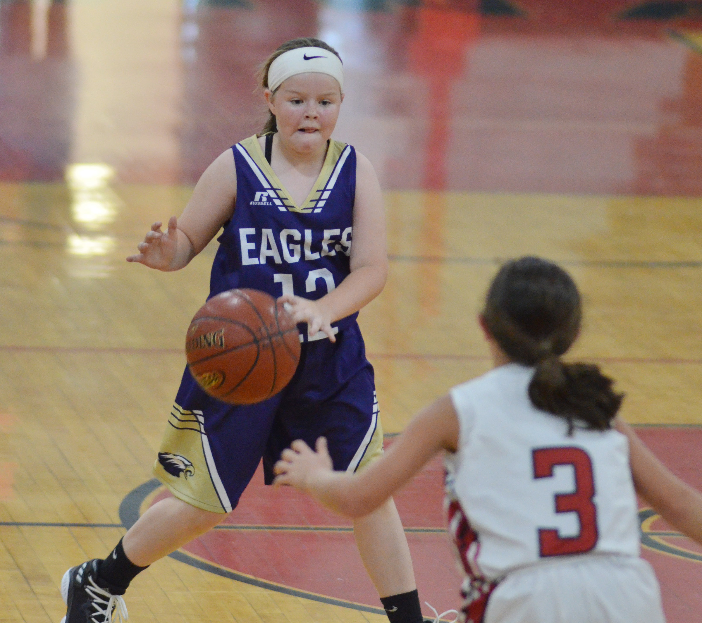 Campbellsville Elementary School fifth-grader Miley Hash looks to pass.
