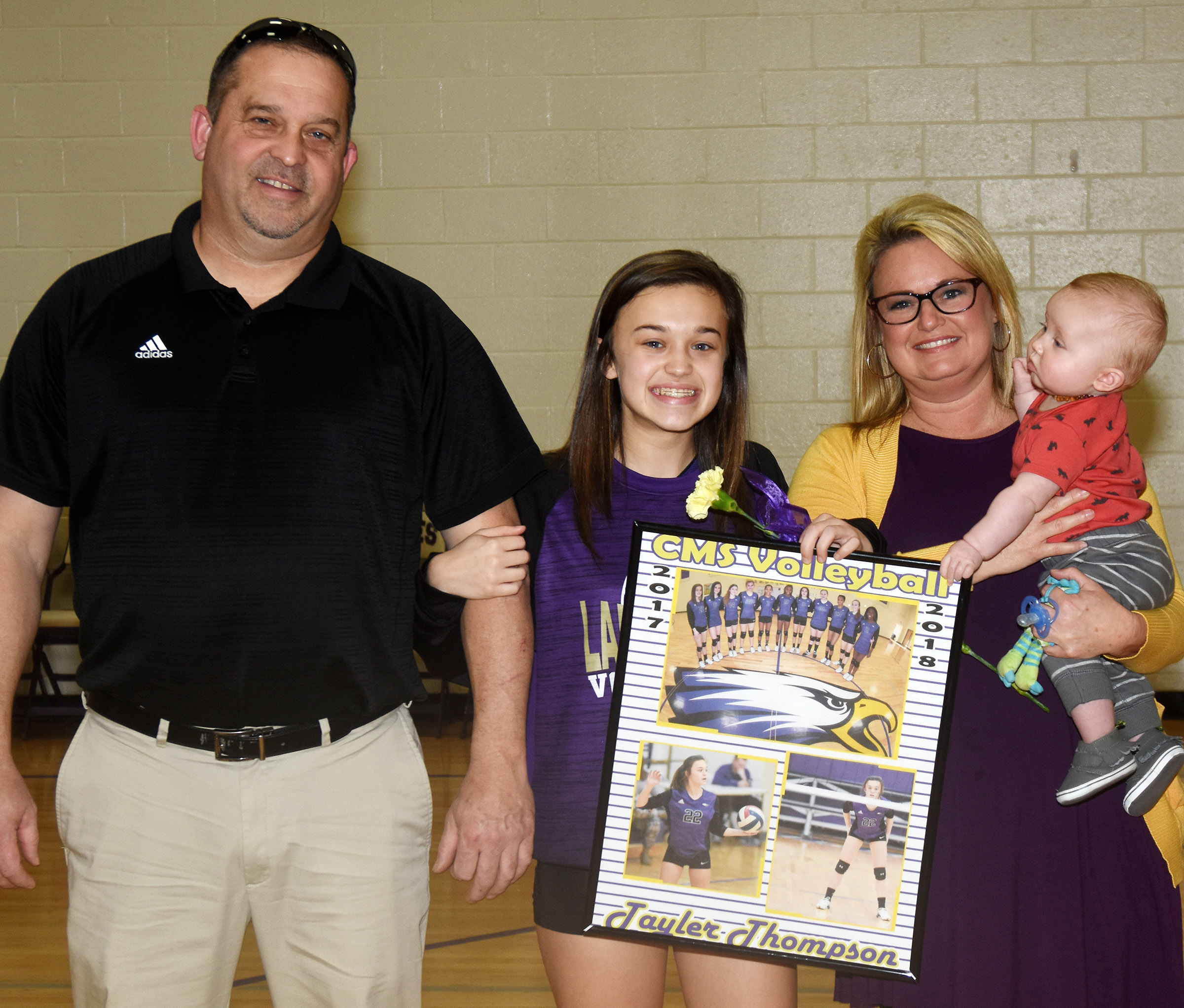 CMS eighth-grader Tayler Thompson is honored for her dedication and hard work this season. She is pictured with her parents, Greg Thompson and Kim Thompson, and her nephew Easton.