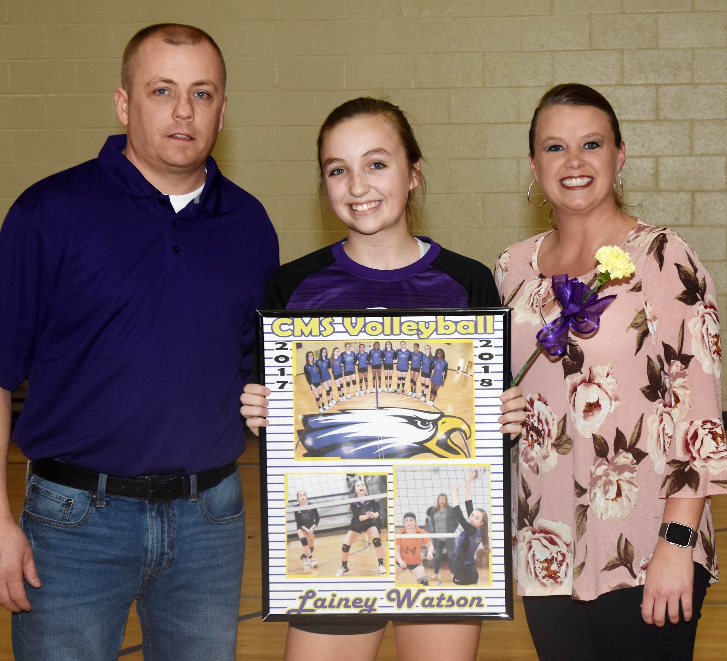 CMS eighth-grader Lainey Watson is honored for her dedication and hard work this season. She is pictured with her parents, Jeff Watson and Jessica Watson.