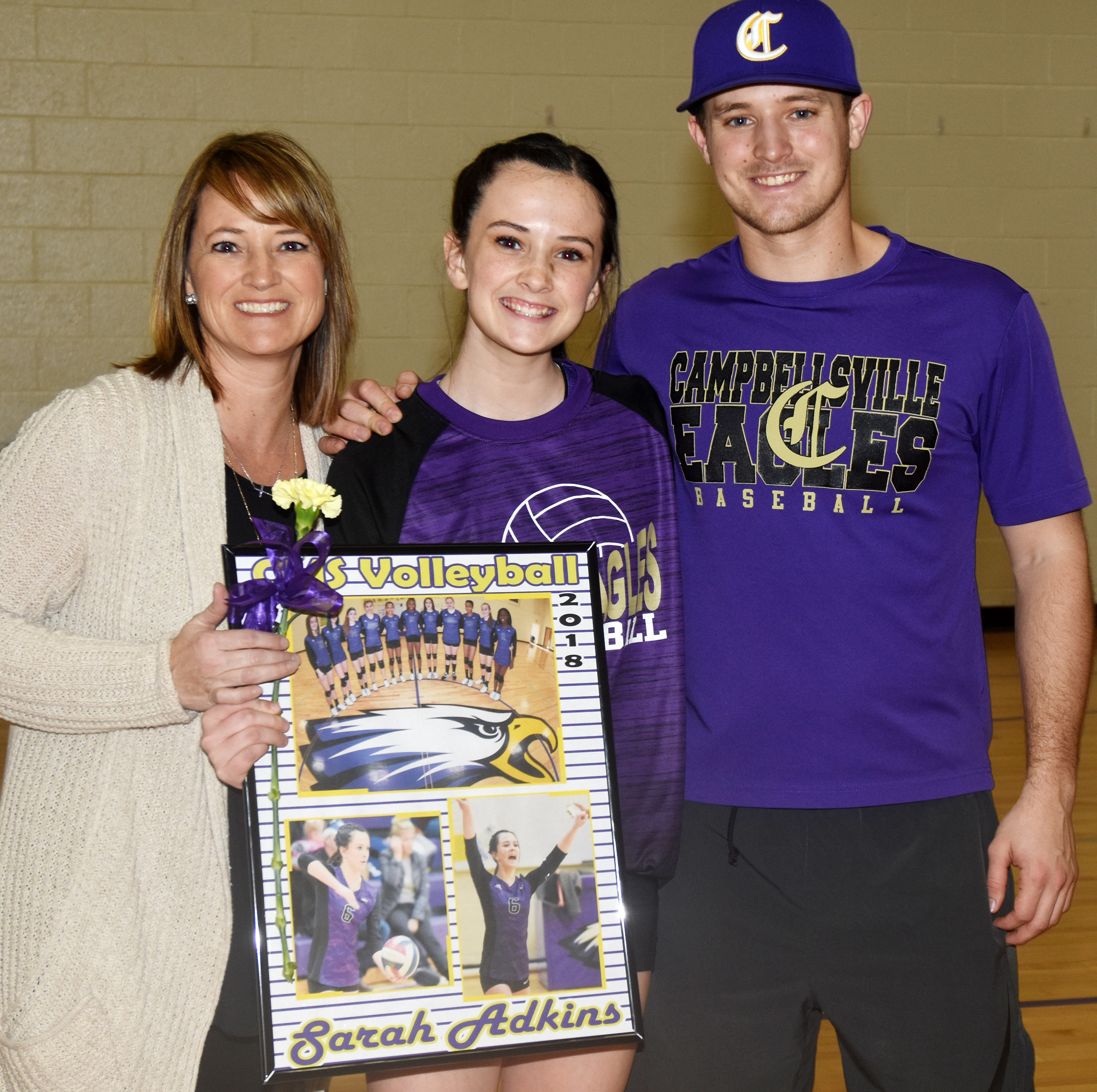 CMS eighth-grader Sarah Adkins is honored for her dedication and hard work this season. She is pictured with her mother, Vanessa, and brother Bradley Bates.