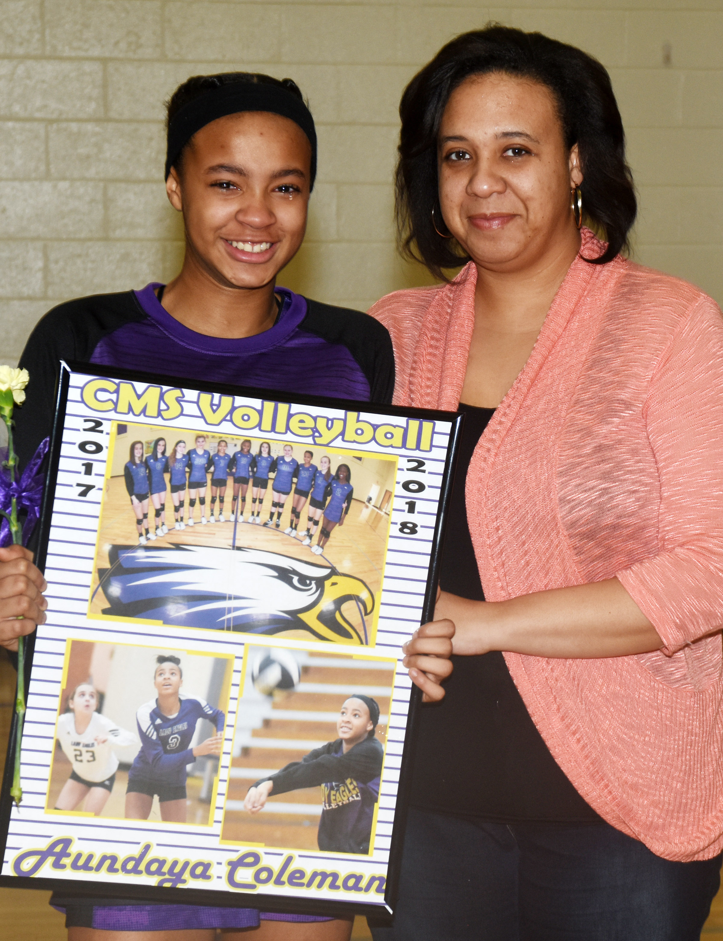 CMS eighth-grader Aundaya Coleman is honored for her dedication and hard work this season. She is pictured with her mother, Cha-Cha Smith.