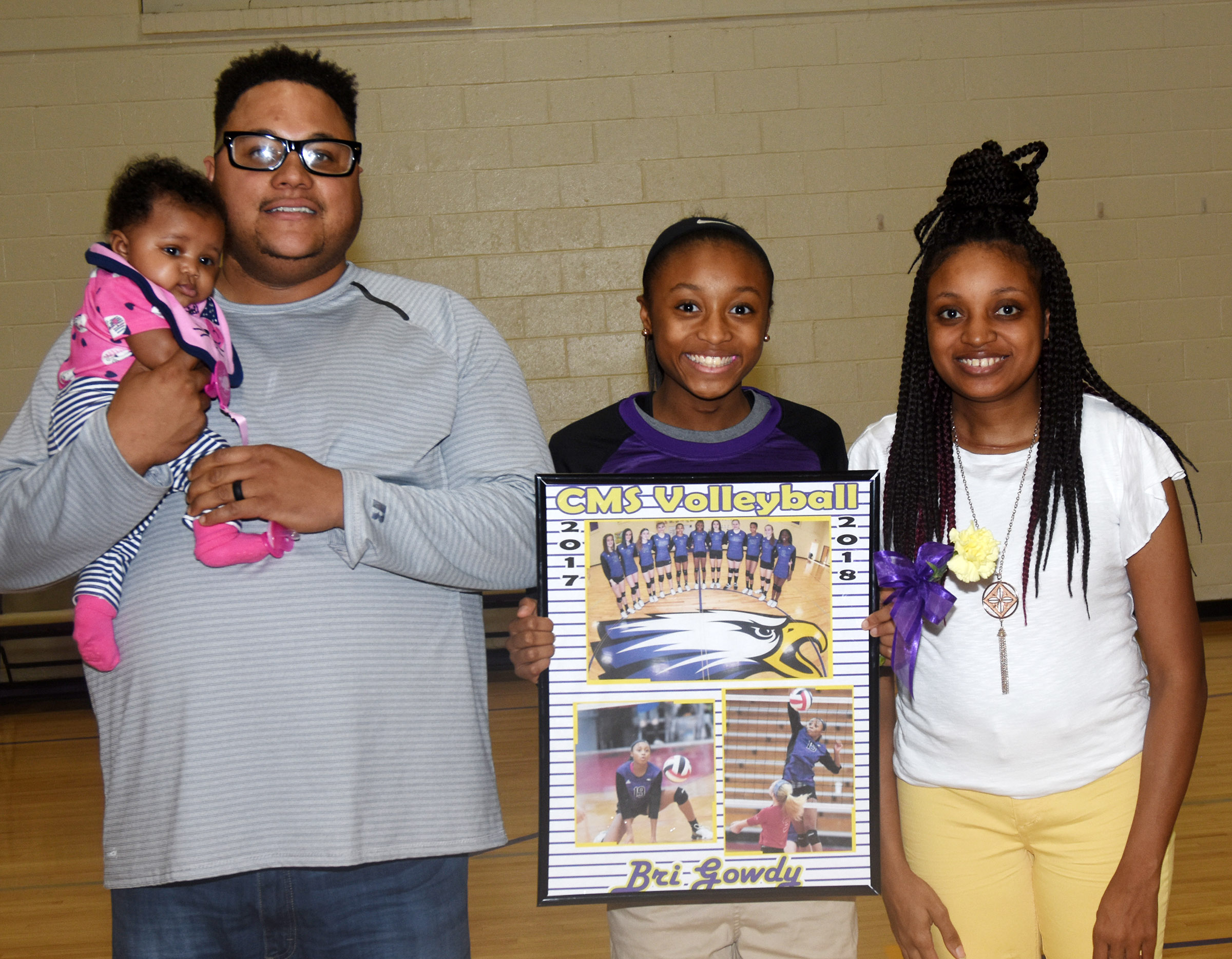 CMS eighth-grader Bri Gowdy is honored for her dedication and hard work this season. She is pictured with her parents, Bronson and Tonya, and her sister, Bronya'.