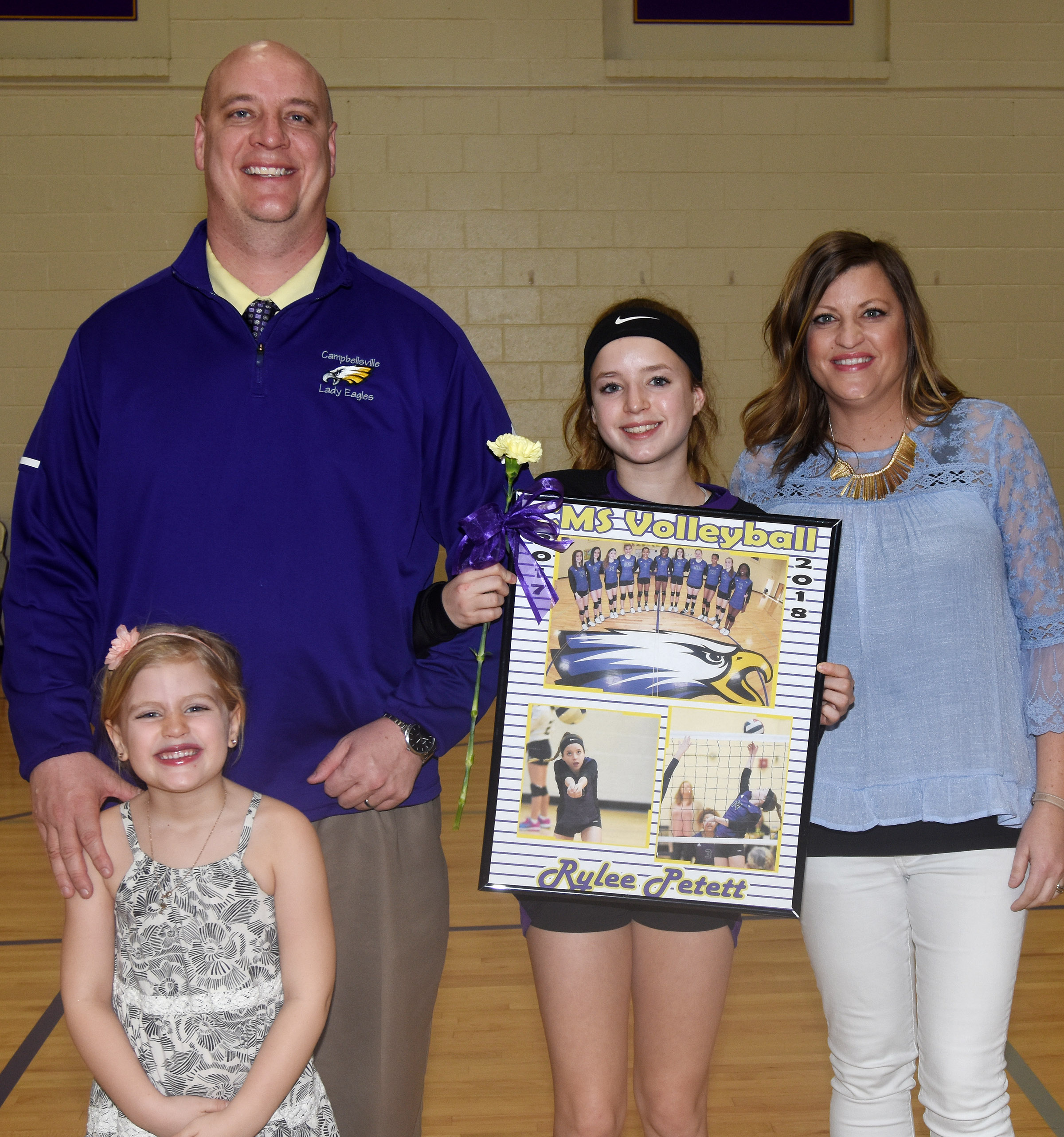 CMS eighth-grader Rylee Petett is honored for her dedication and hard work this season. She is pictured with her parents, David and Ashlee, and sister Remi.