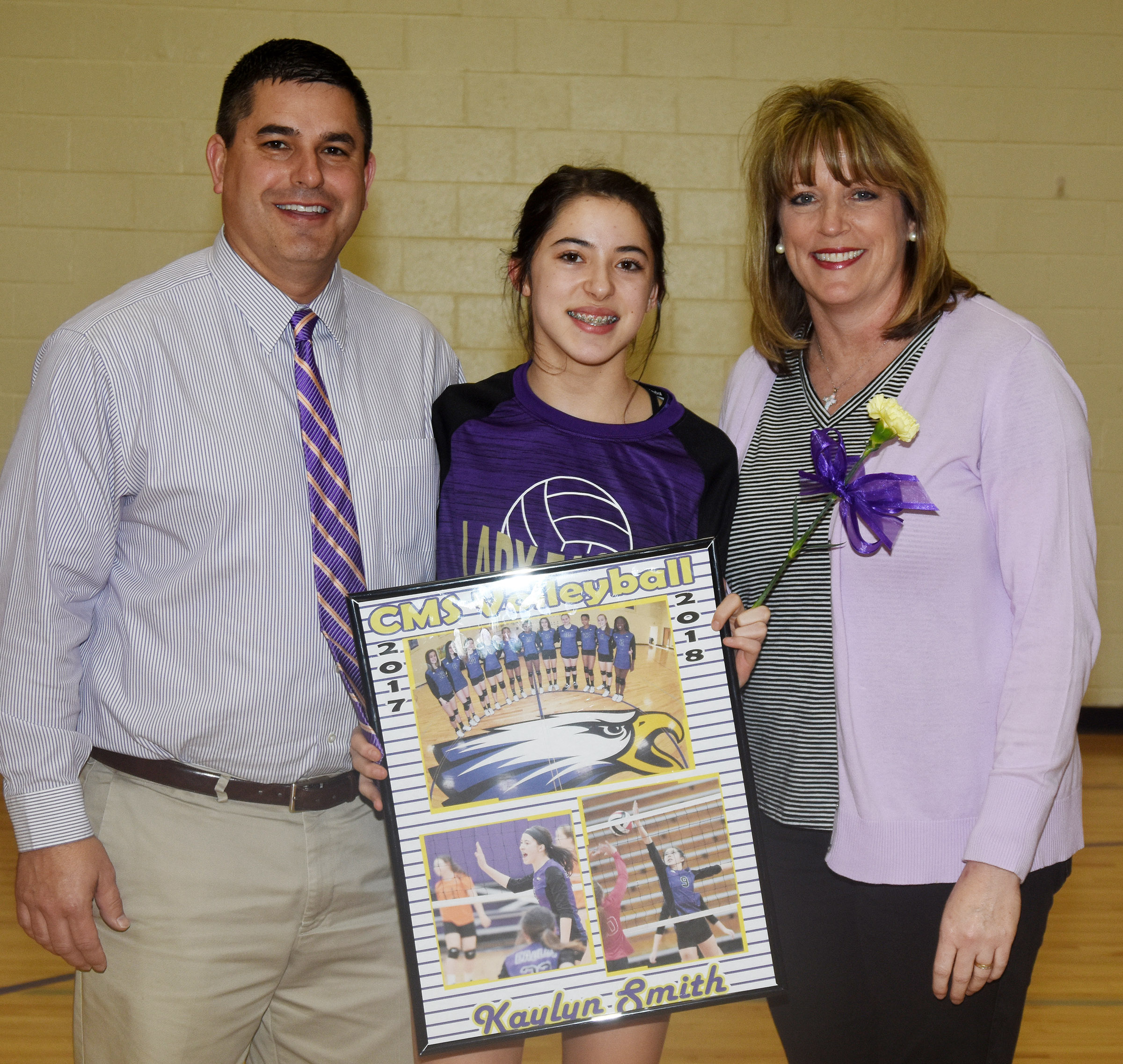 CMS eighth-grader Kaylyn Smith is honored for her dedication and hard work this season. She is pictured with her parents, Kirby and Andrea.