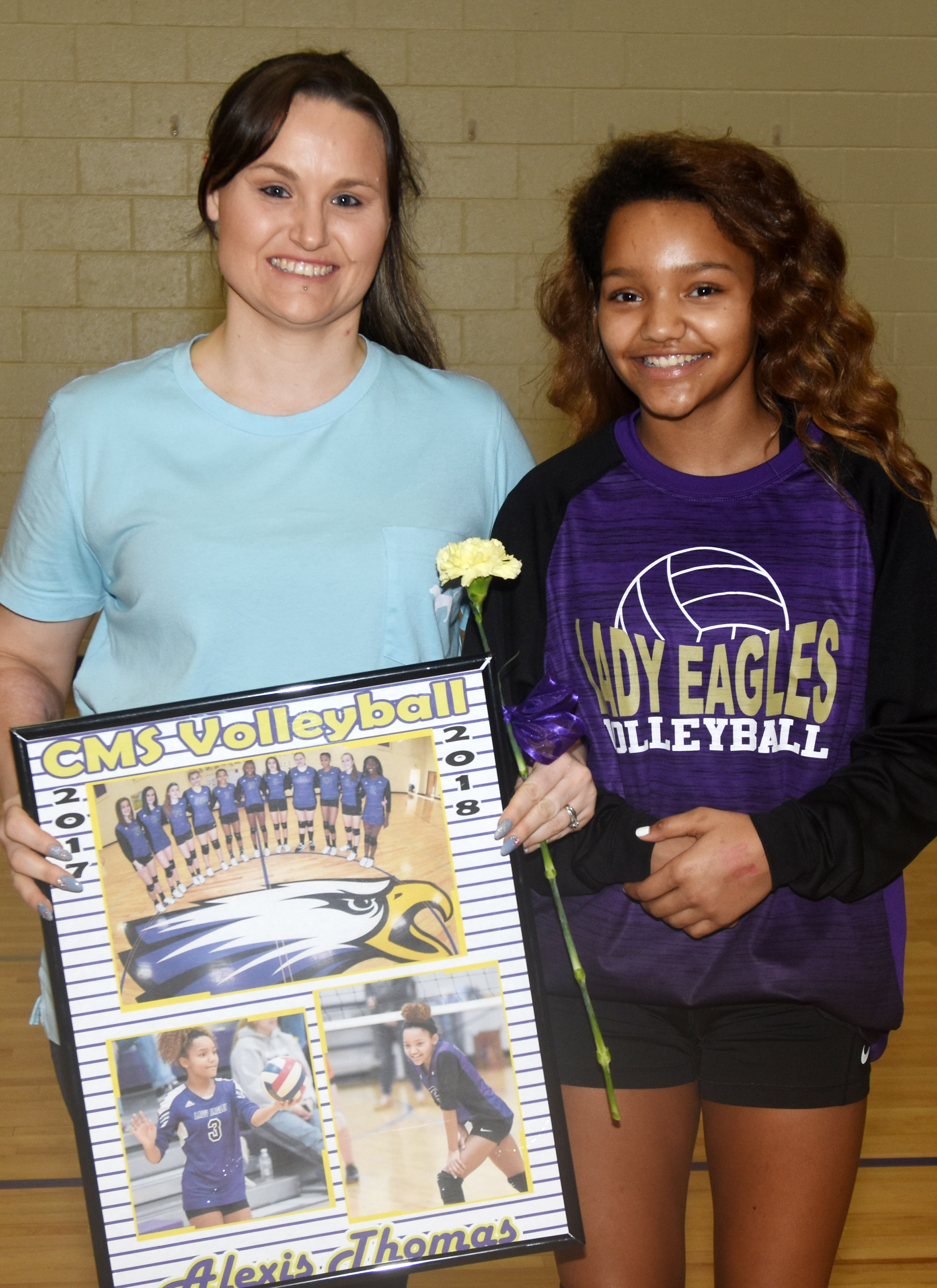 CMS eighth-grader Alexis Thomas is honored for her dedication and hard work this season. She is pictured with her mother, Loretta Simmons.