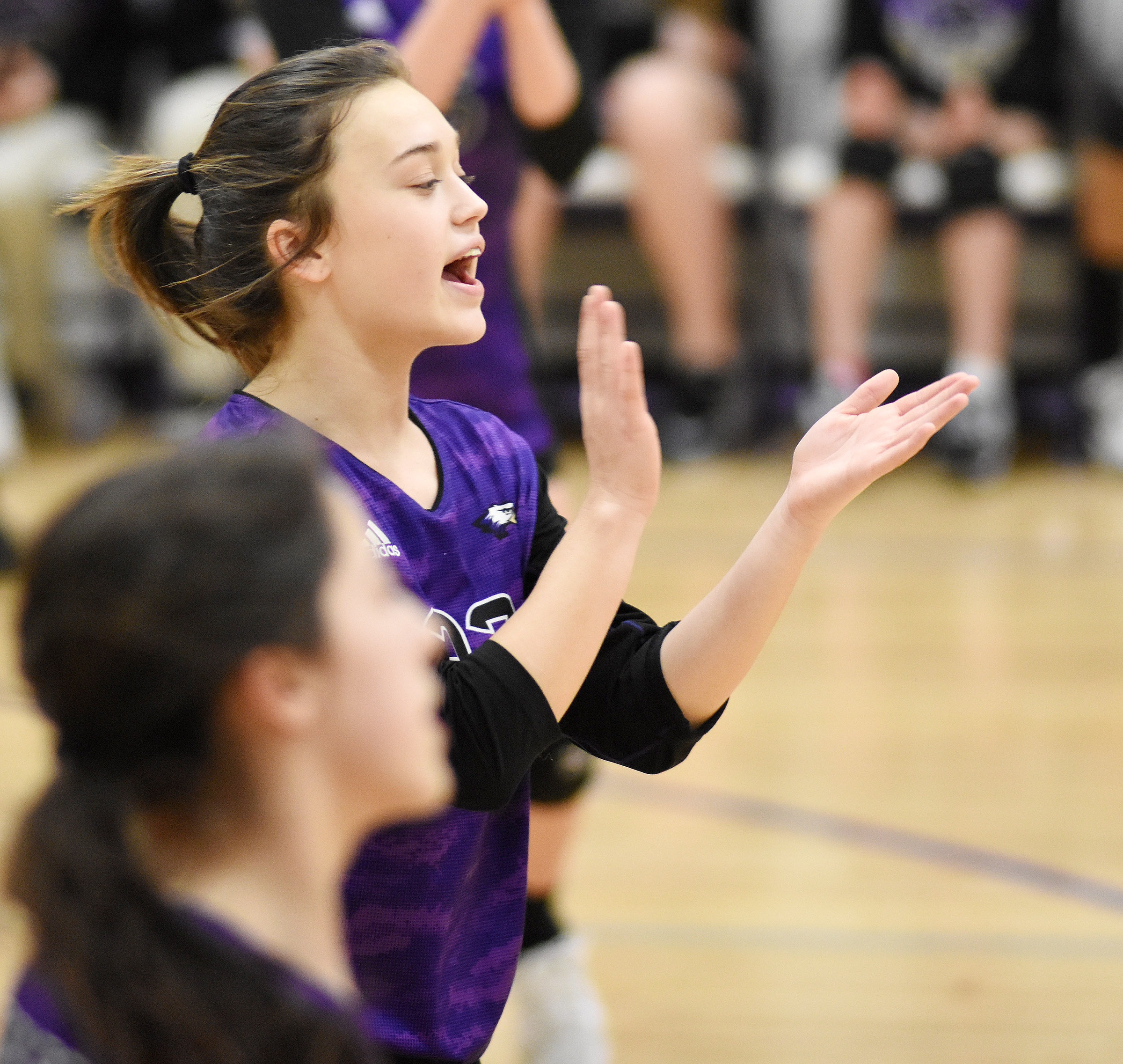 CMS eighth-grader Tayler Thompson cheers for her team.