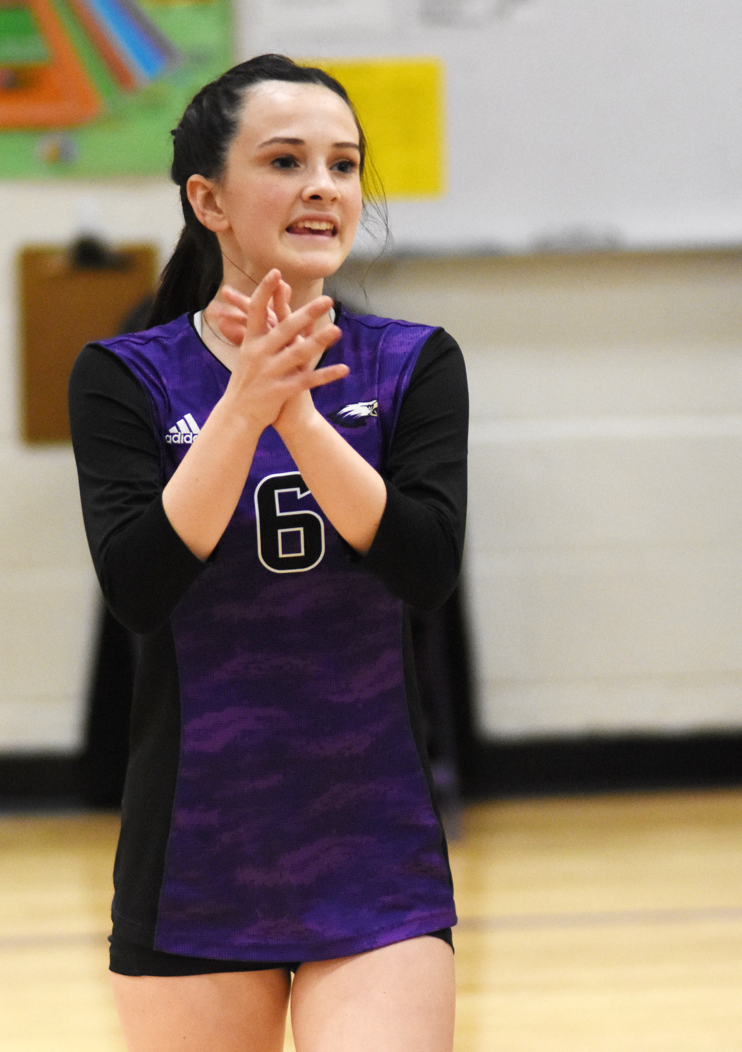 CMS eighth-grader Sarah Adkins cheers for her team.