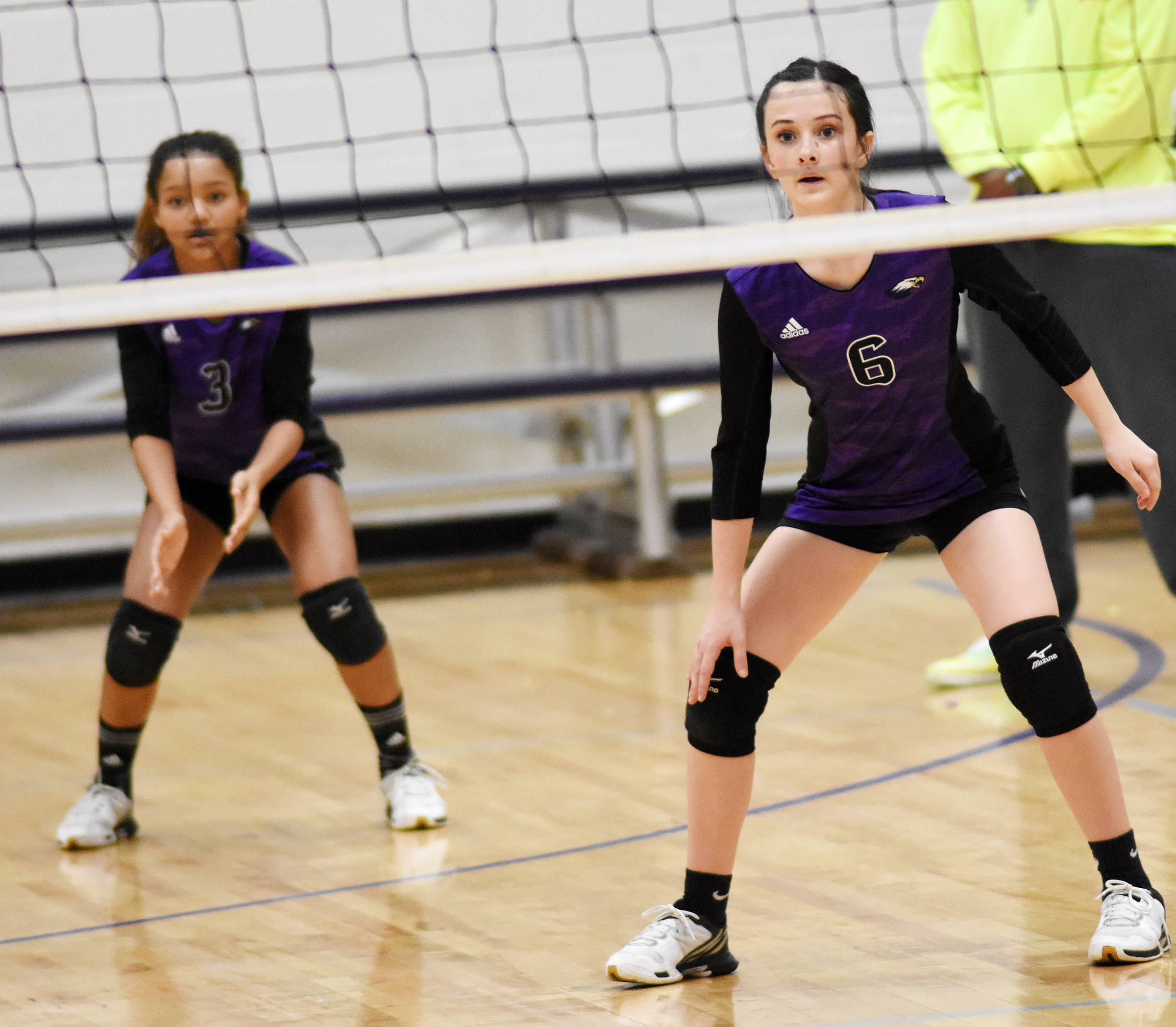 CMS eighth-graders Alexis Thomas, at left, and Sarah Adkins watch the ball.