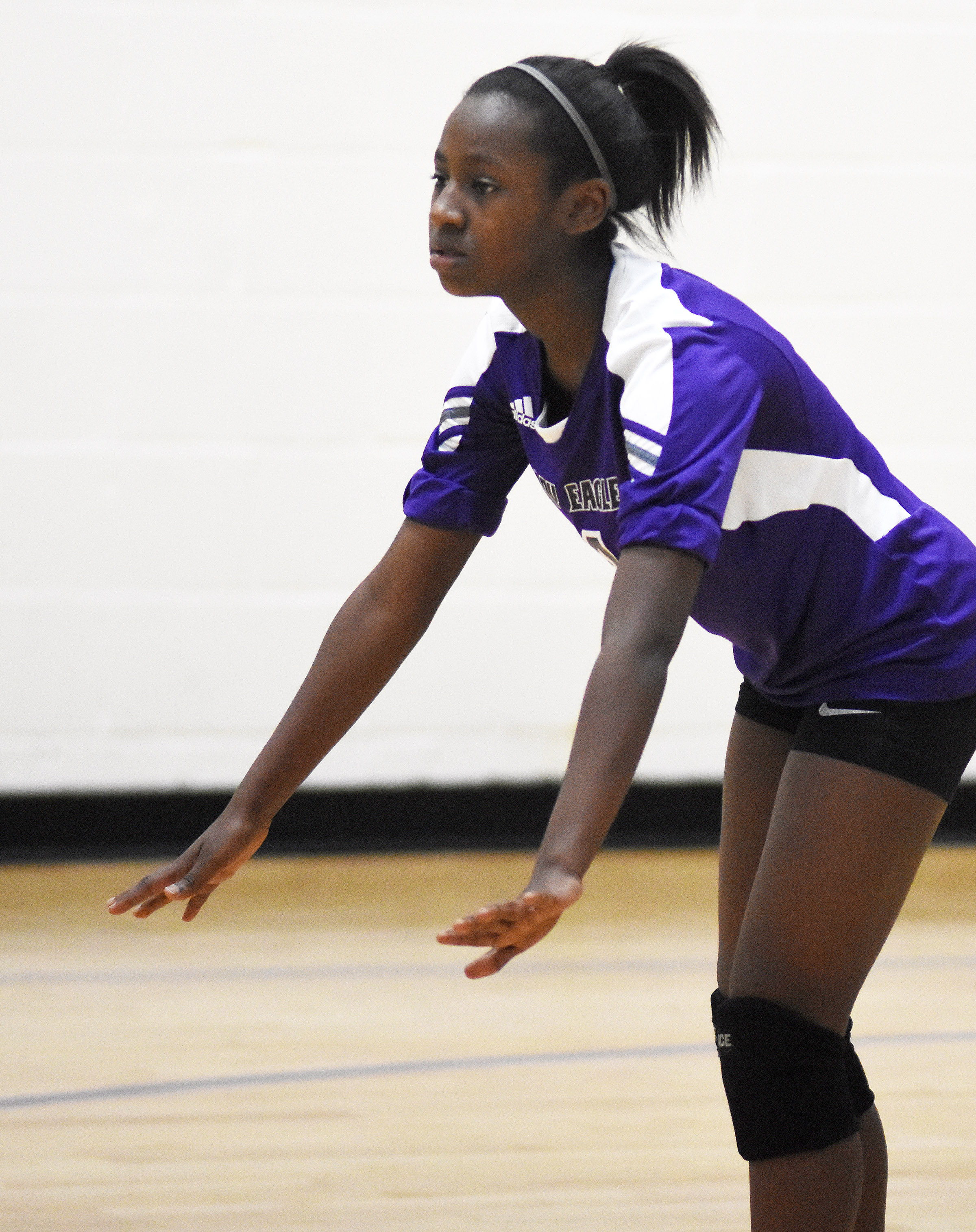 CMS eighth-grader Myricle Gholston gets ready for the serve.