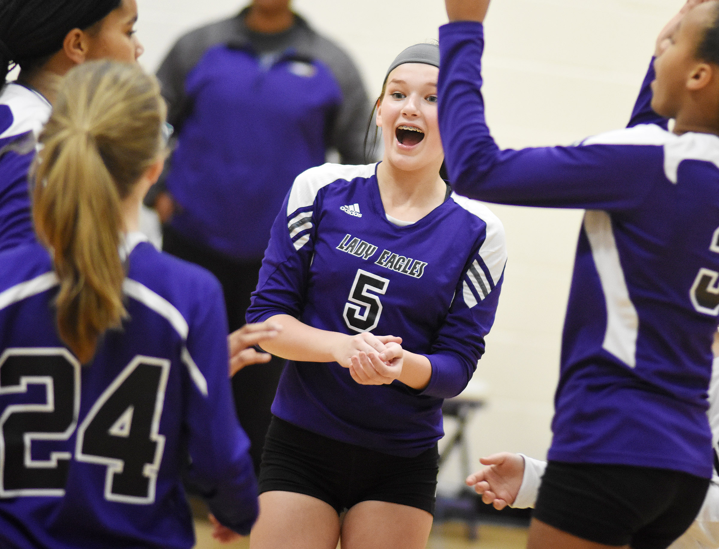 CMS seventh-grader BreAnna Humphress celebrates a point with her teammates.