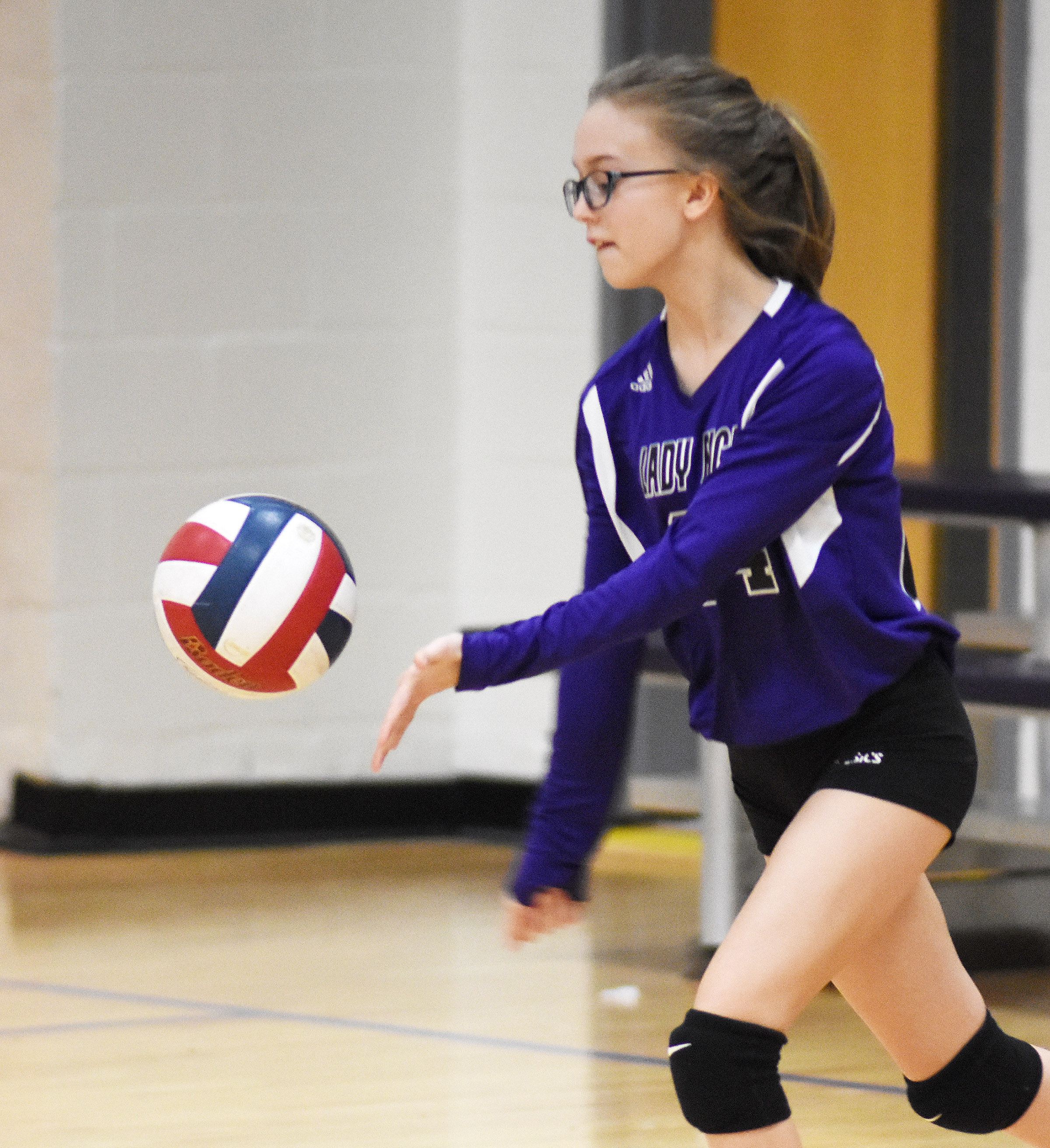CMS sixth-grader Chloe Thompson serves.