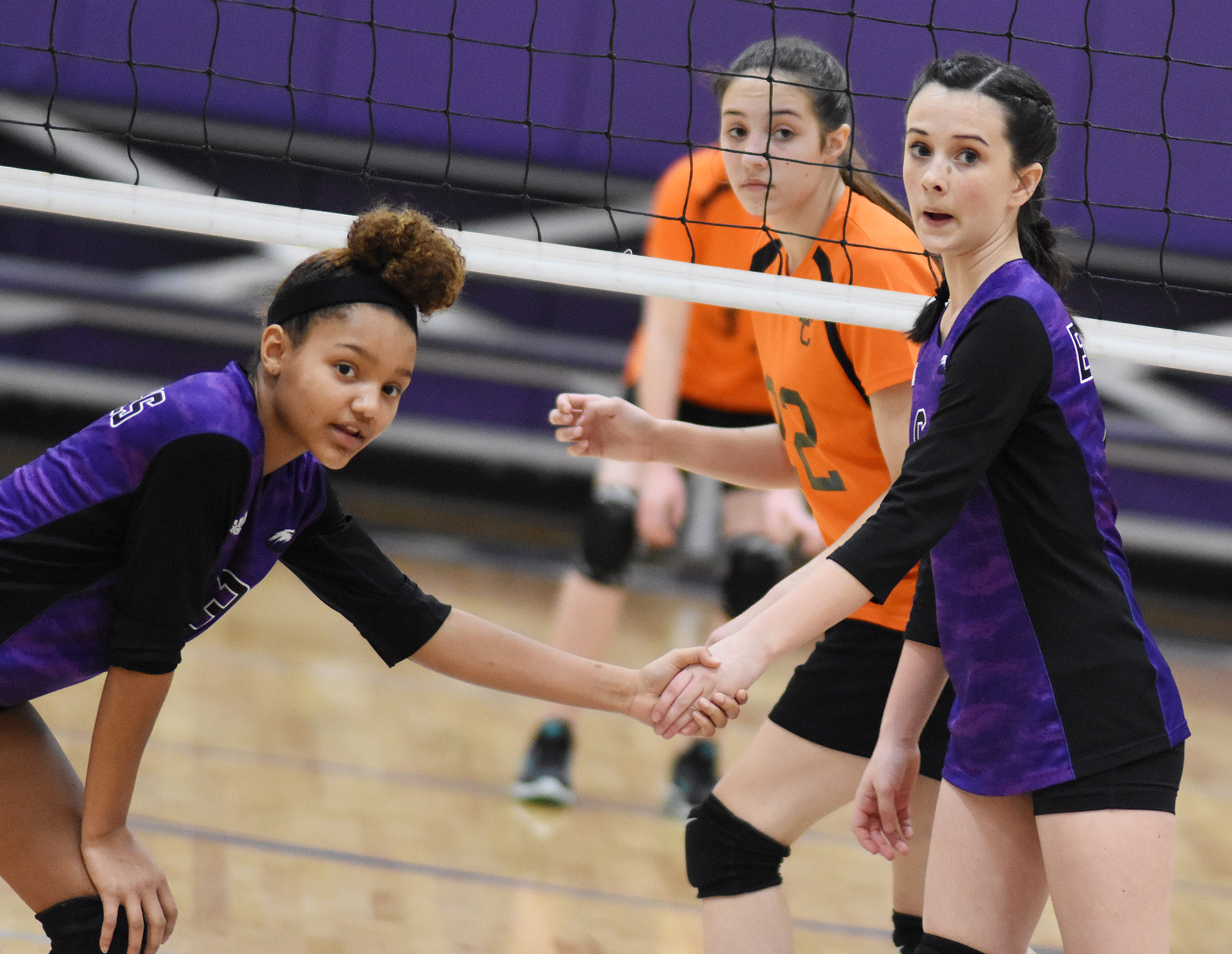 CMS eighth-grader Alexis Thomas, at left, and Sarah Adkins watch the serve.