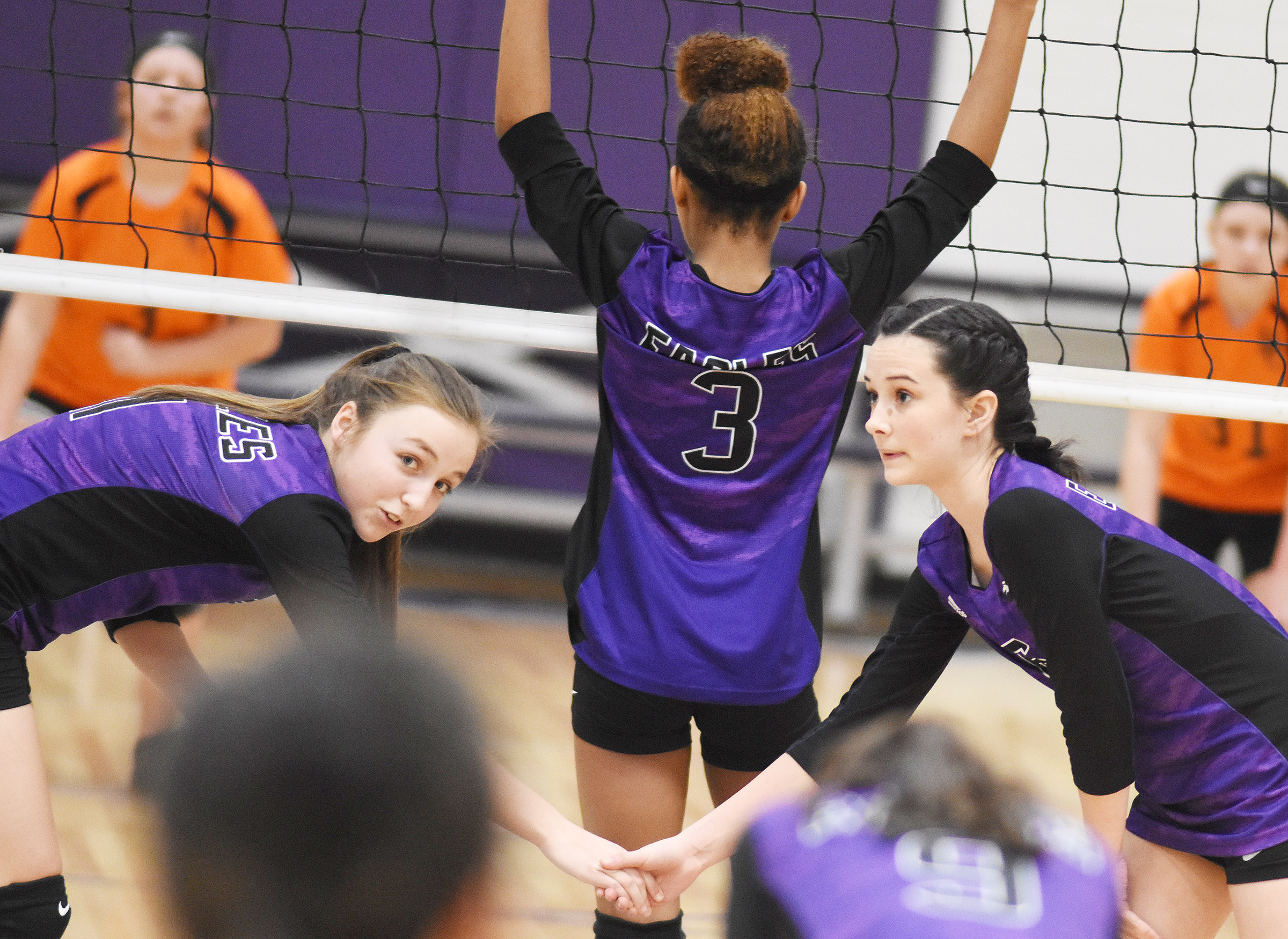 CMS eighth-graders Lainey Watson, at left, and Sarah Adkins watch the serve.