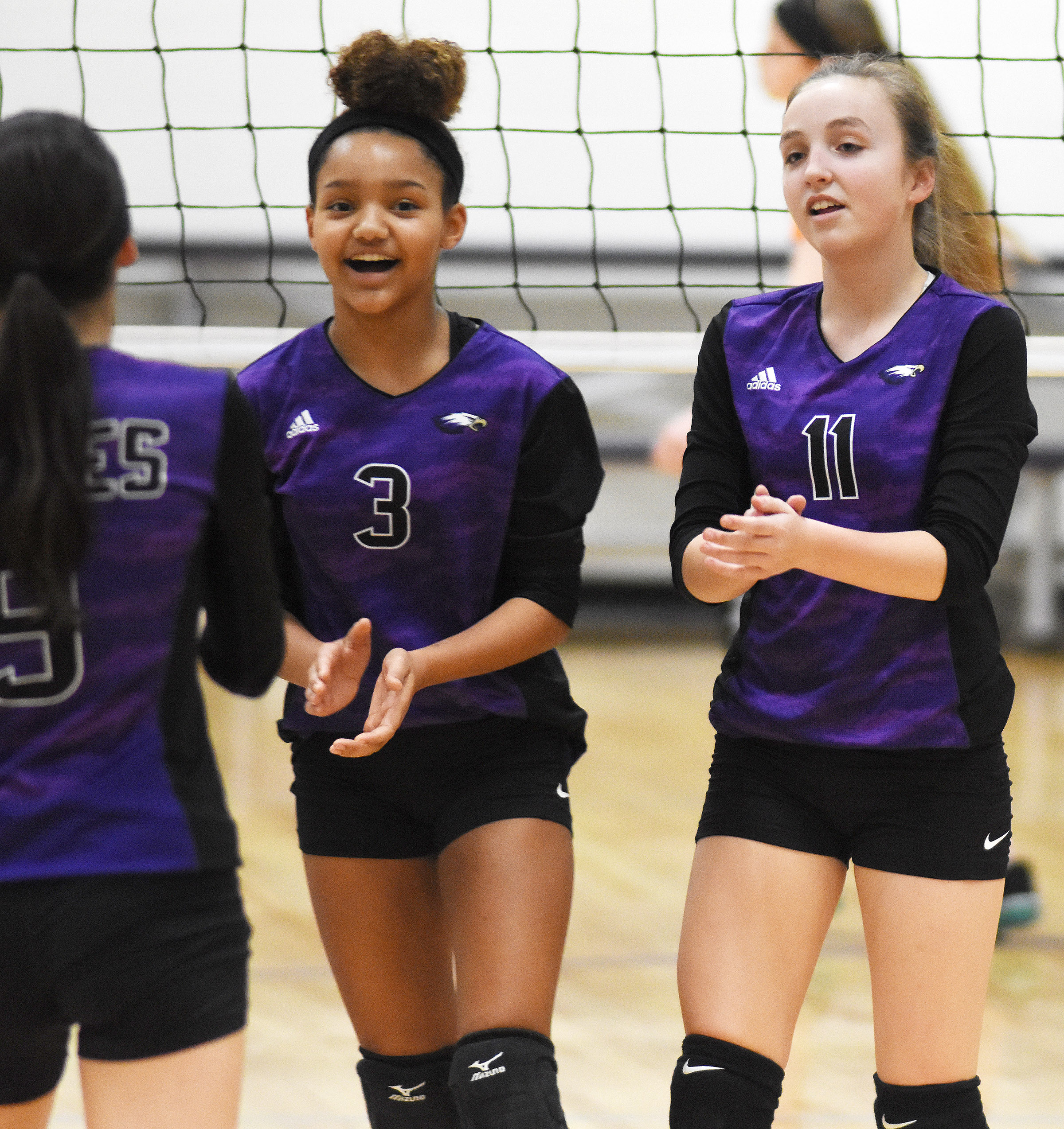 CMS eighth-graders Alexis Thomas, at left, and Lainey Watson cheer after a point.