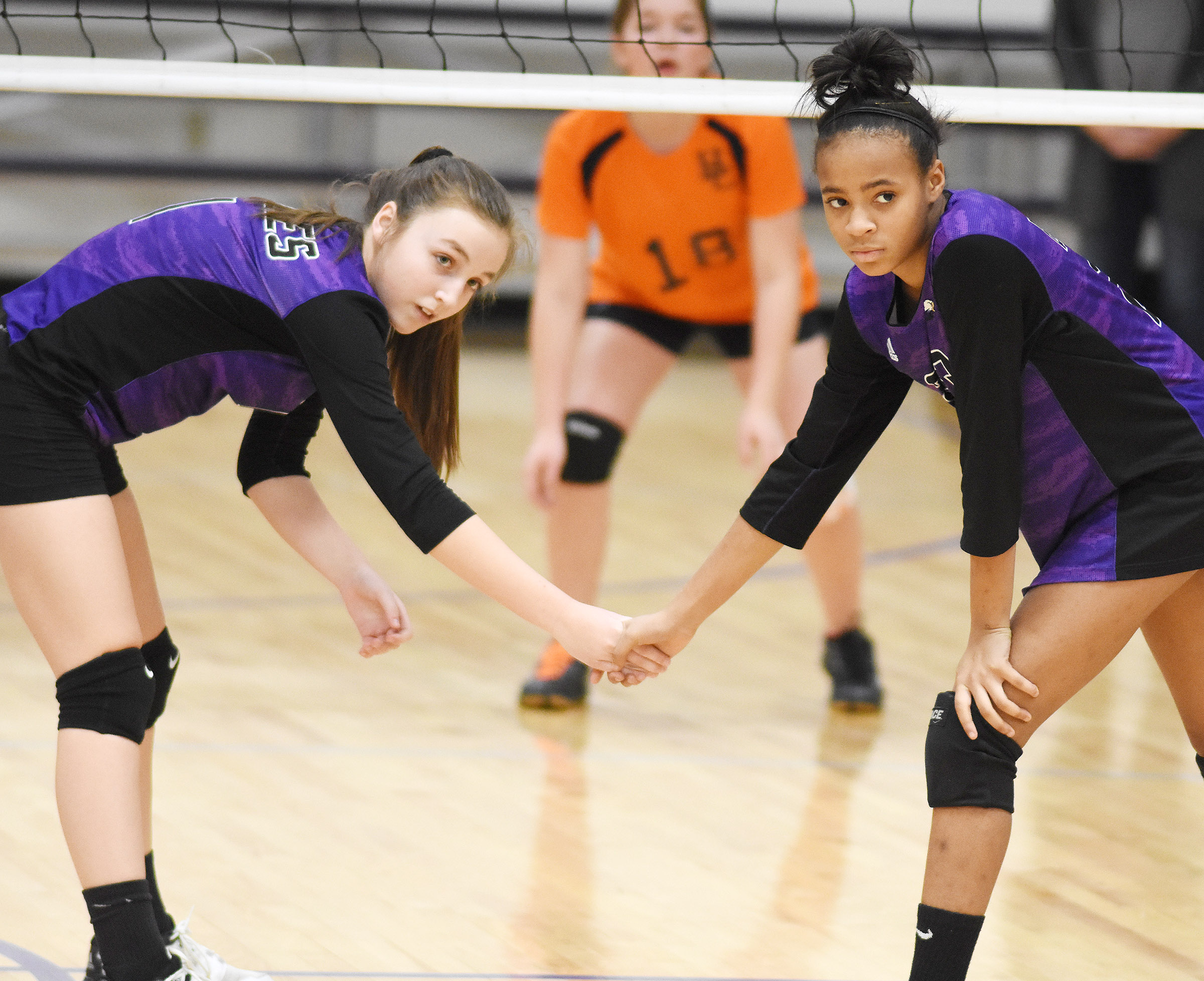 CMS eighth-graders Lainey Watson, at left, and Aundaya Coleman watch the serve.