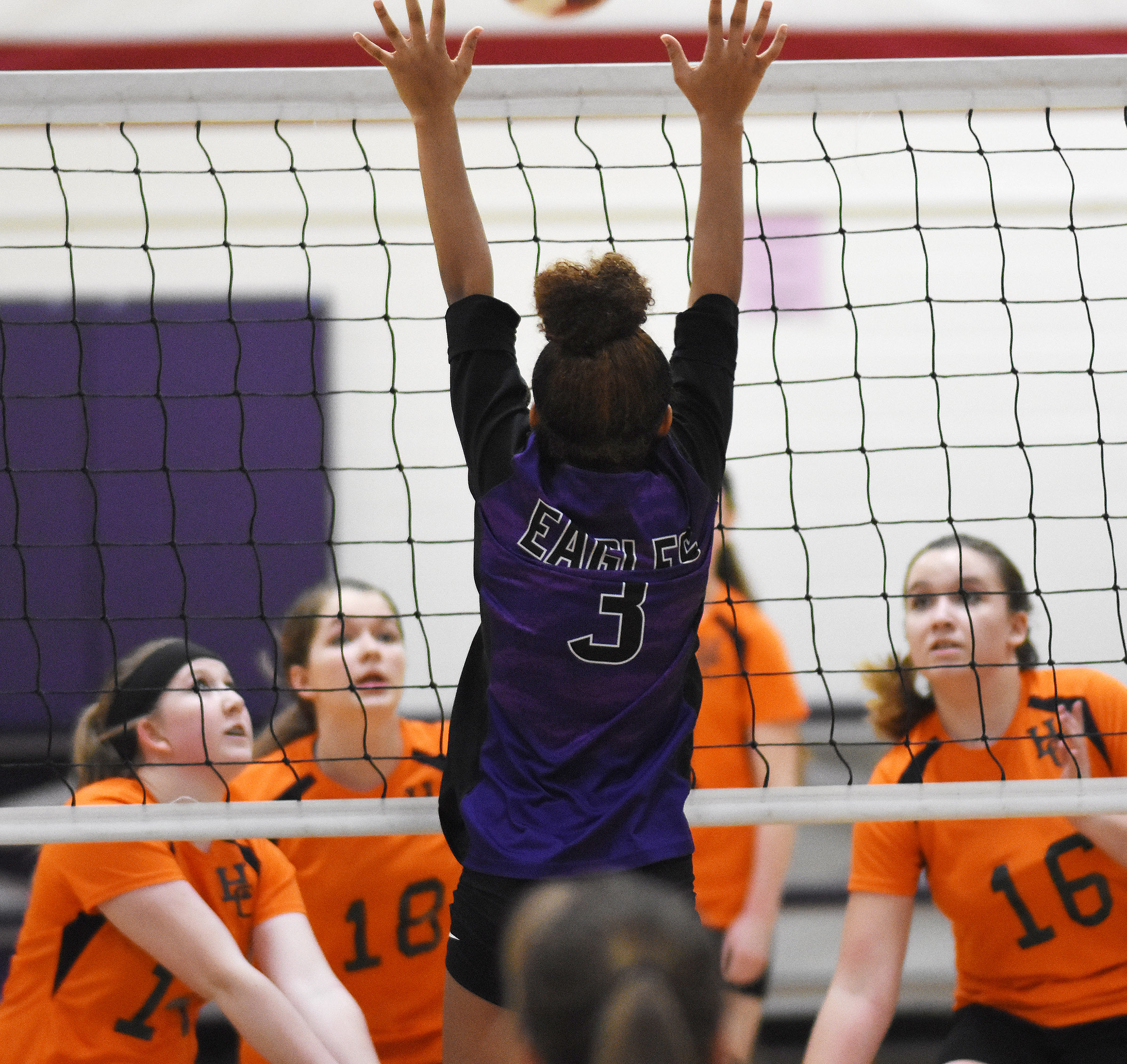 CMS eighth-grader Alexis Thomas jumps to block the ball.