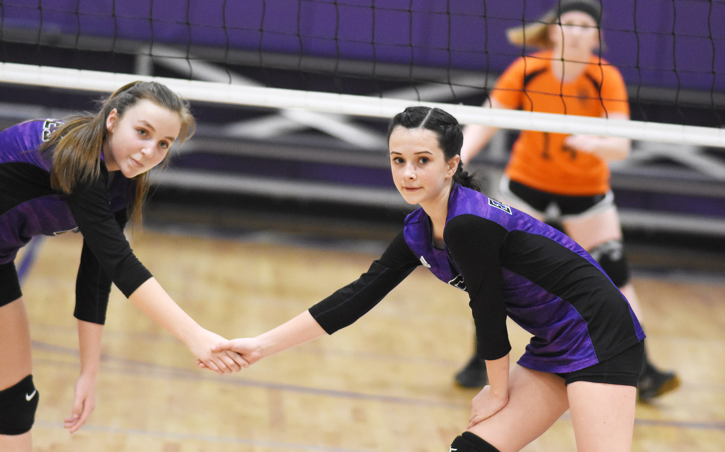 CMS eighth-grader Lainey Watson, at left, and Sarah Adkins watch the serve.