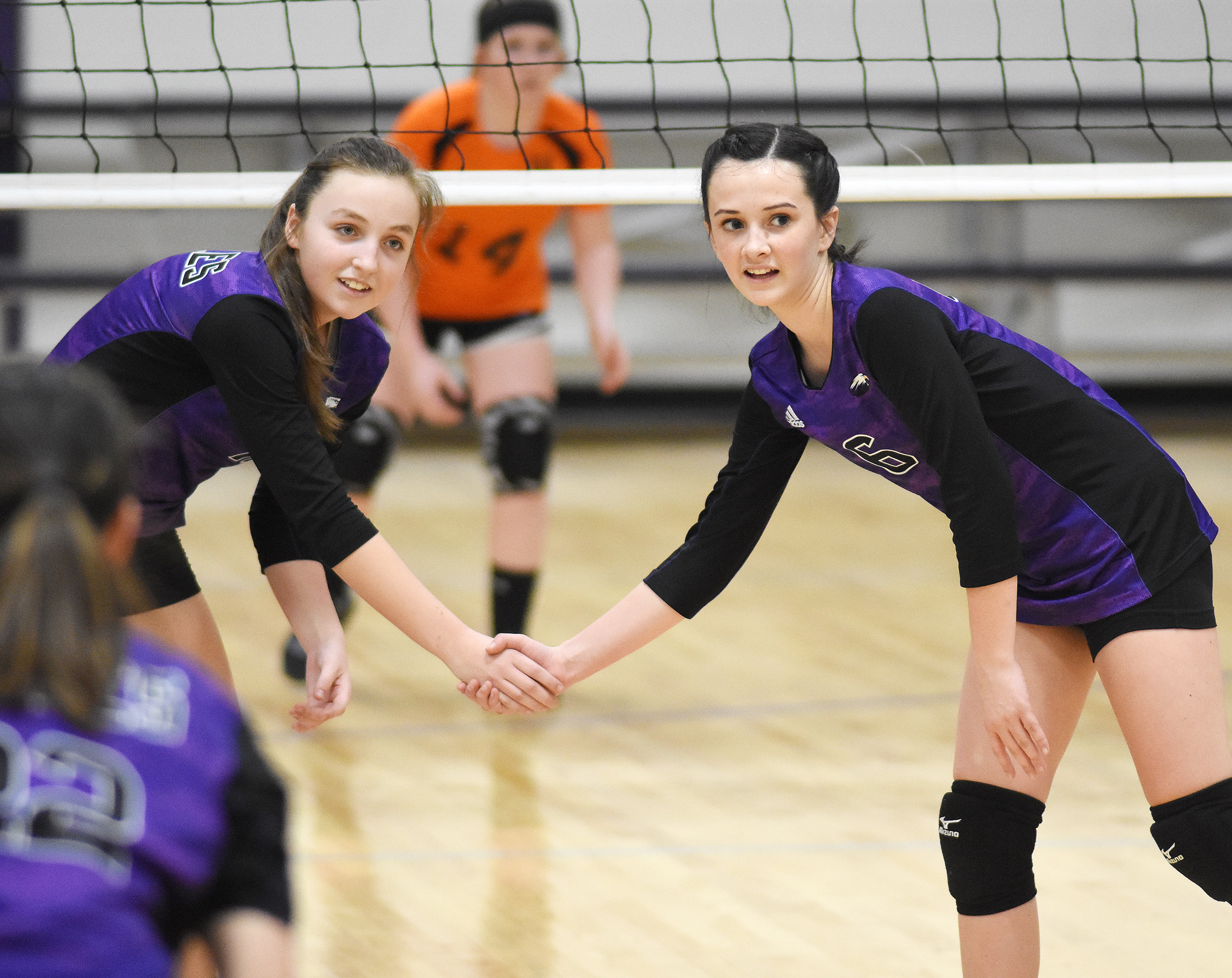 CMS eighth-grader Lainey Watson, at left, and Sarah Adkins wait for the serve.