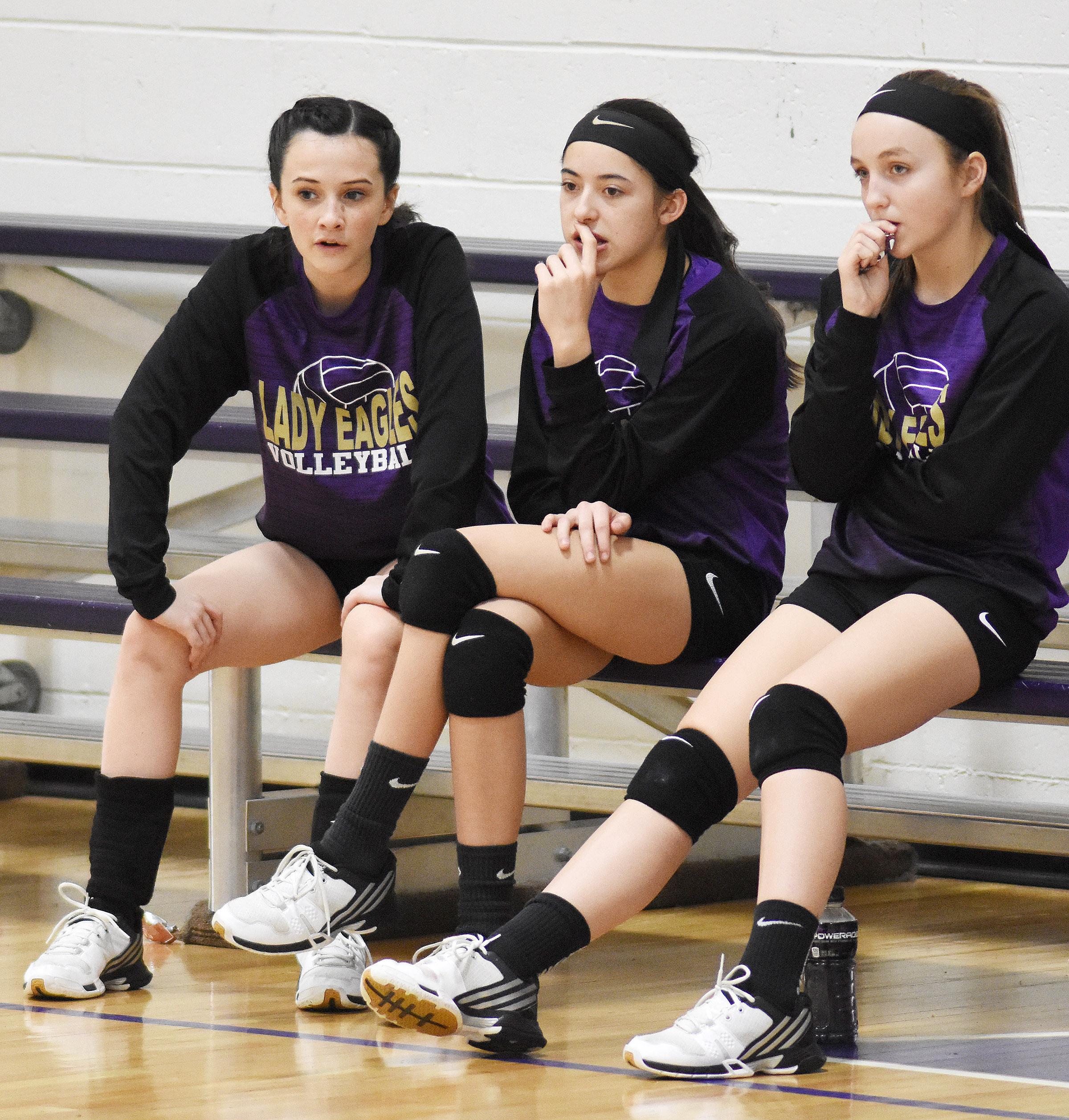 From left, CMS eighth-graders Sarah Adkins, Kaylyn Smith and Lainey Watson watch as their seventh-grade teammates play.