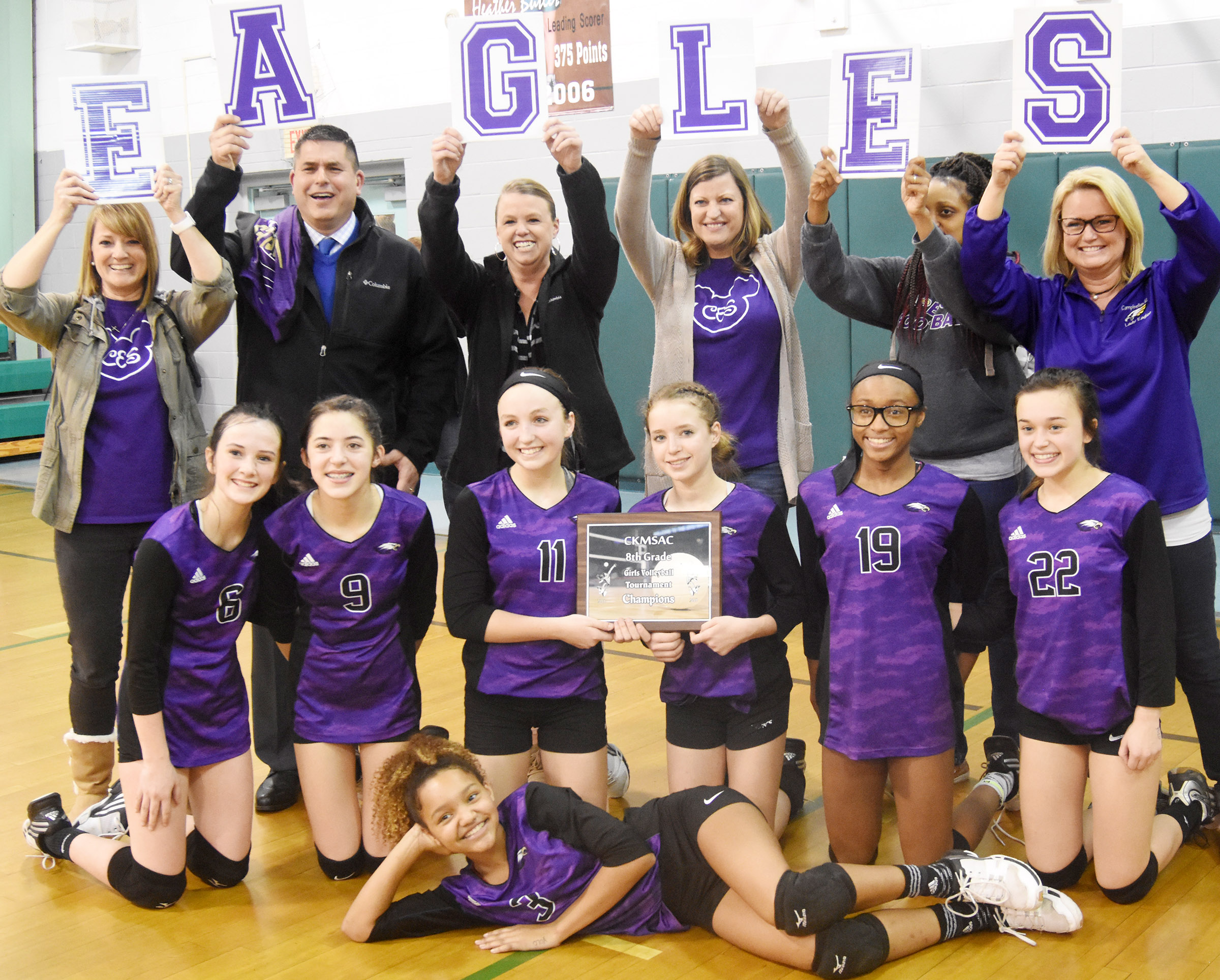 CMS eighth-grade volleyball players pose for a photo with their parents. In front is Alexis Thomas. Second row, from left, Sarah Adkins, Kaylyn Smith, Lainey Watson, Rylee Petett, Bri Gowdy and Tayler Thompson. Back, Vanessa Adkins, Kirby Smith, Jessica Watson, Ashlee Petett, Tonya Gowdy and Kim Thompson.