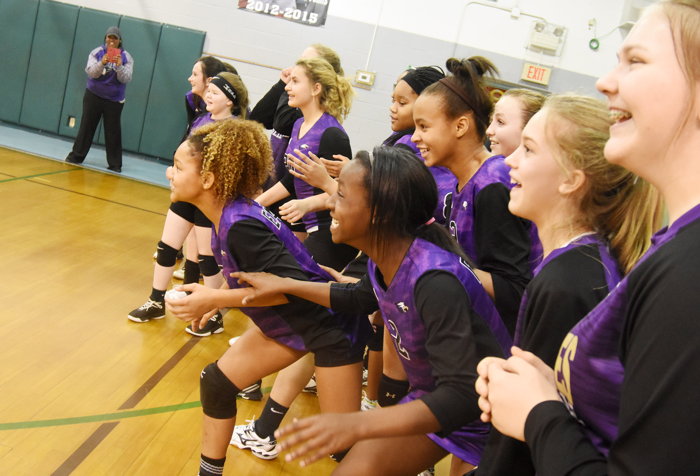 CMS volleyball players wait as they are announced CKMSAC tournament champions.