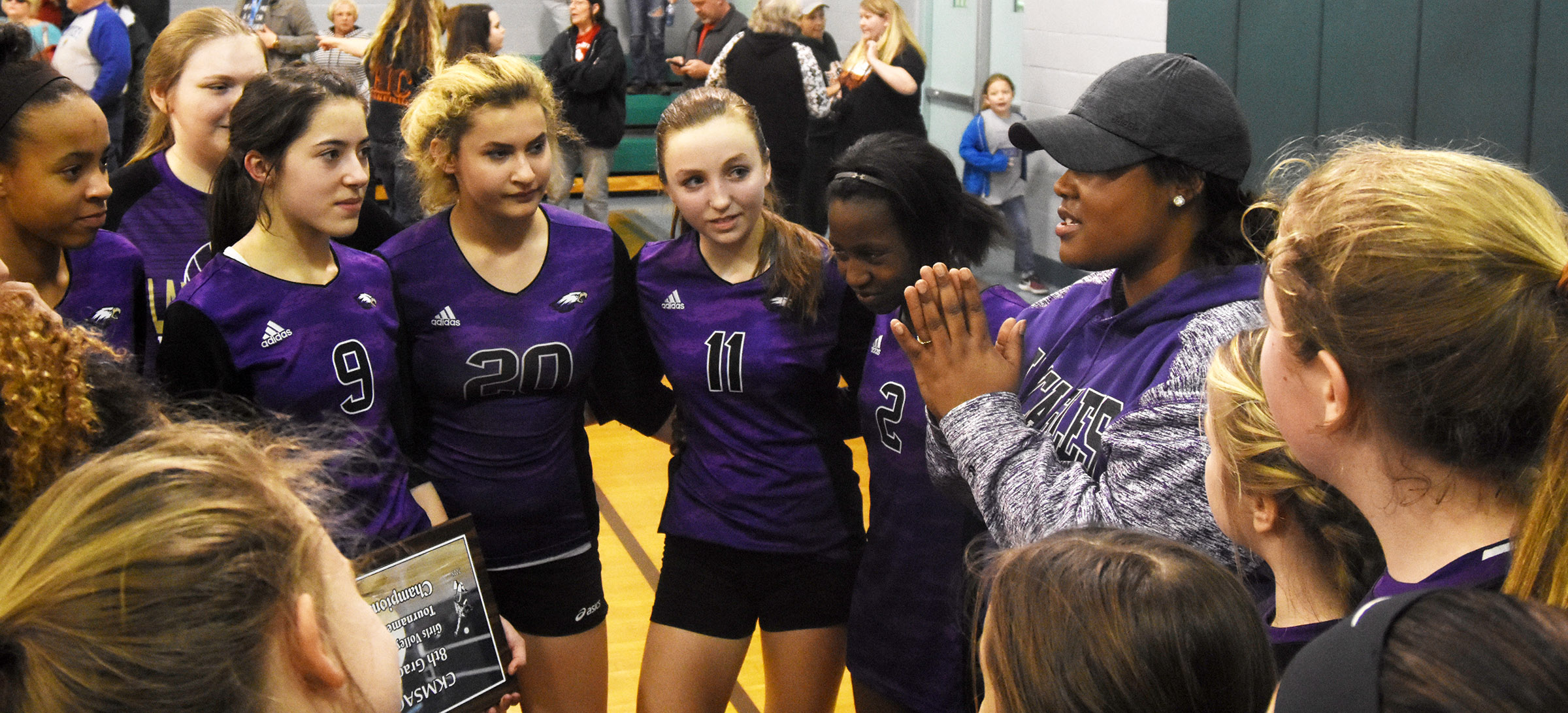 CMS volleyball coach Shajuna Ditto talks to her players after they are announced as CKMSAC tournament champions.