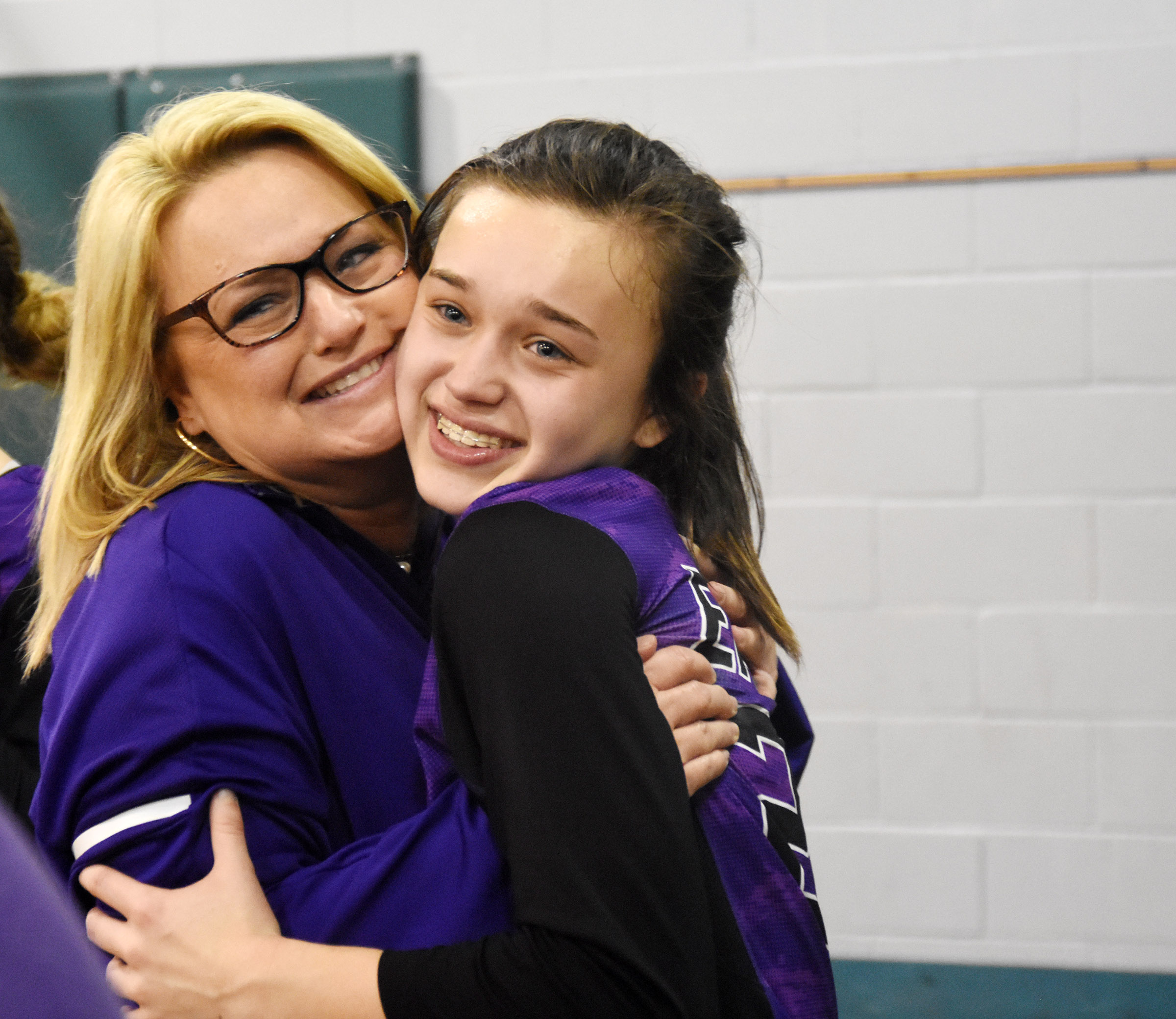 CMS eighth-grader Tayler Thompson receives a hug from her mother Kim.