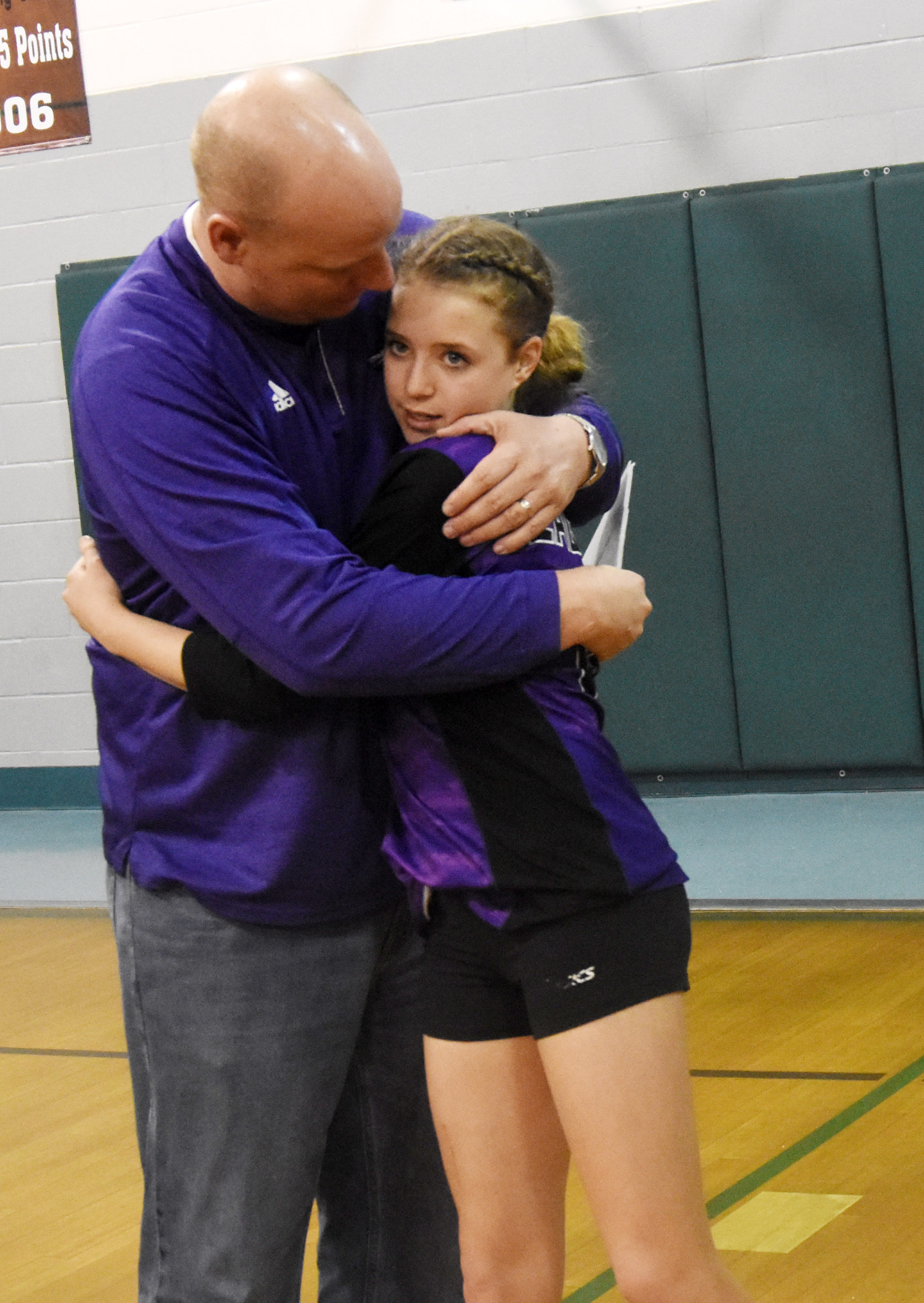 CMS eighth-grader Rylee Petett receives a hug from her father David.