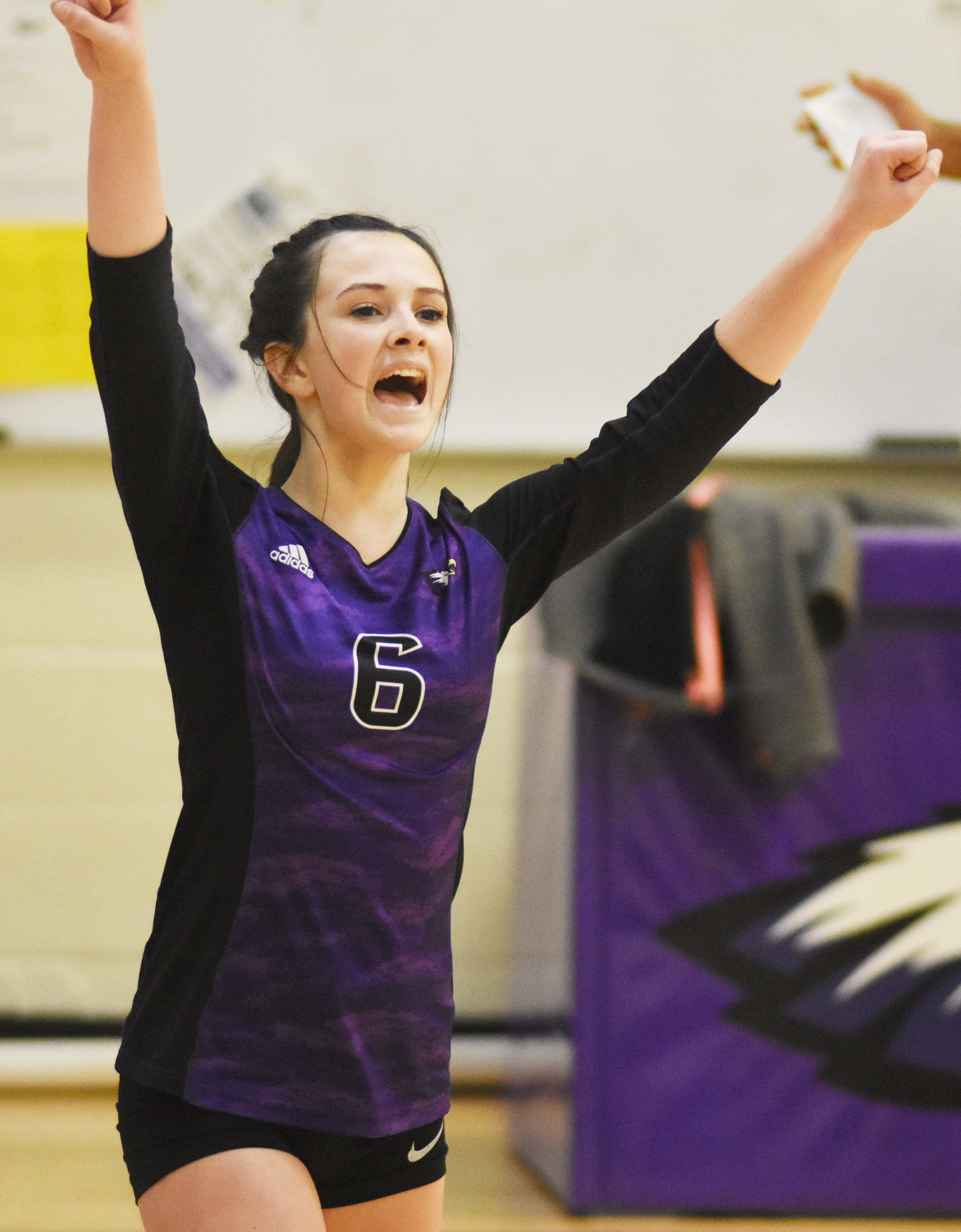 CMS eighth-grader Sarah Adkins cheers after a point.