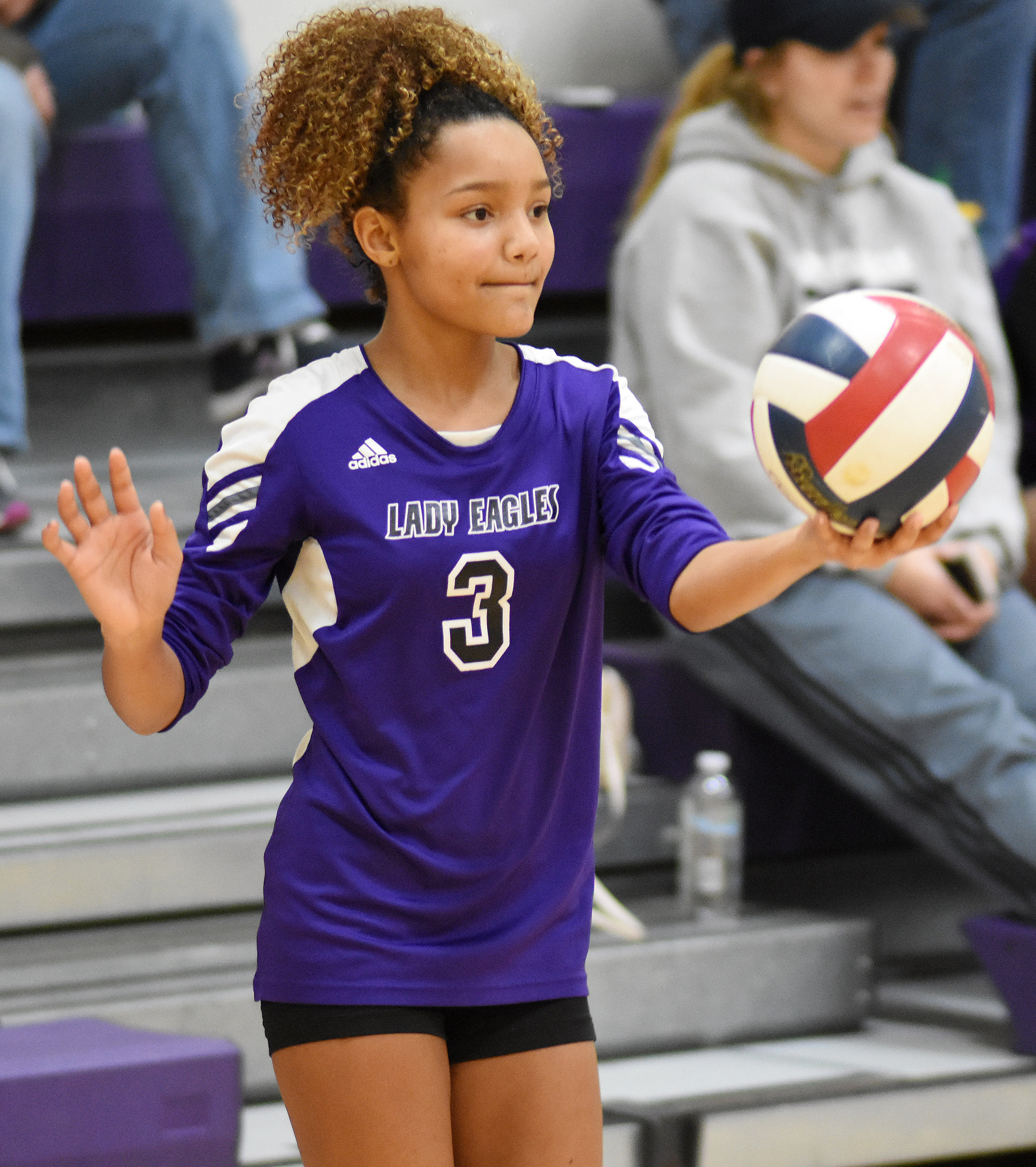 CMS eighth-grader Alexis Thomas serves.