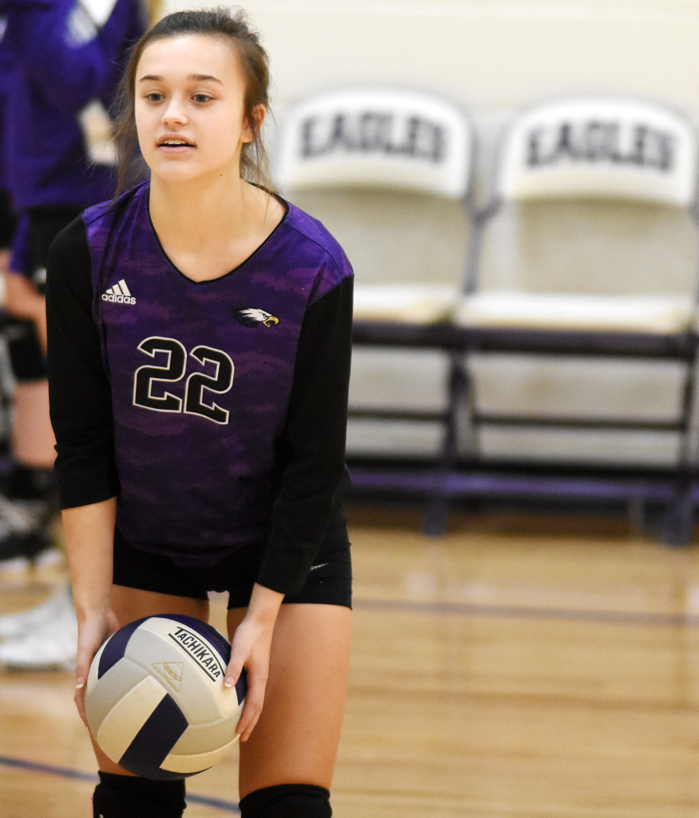 CMS eighth-grader Tayler Thompson bounces a ball with her teammates as they warm up before their match.
