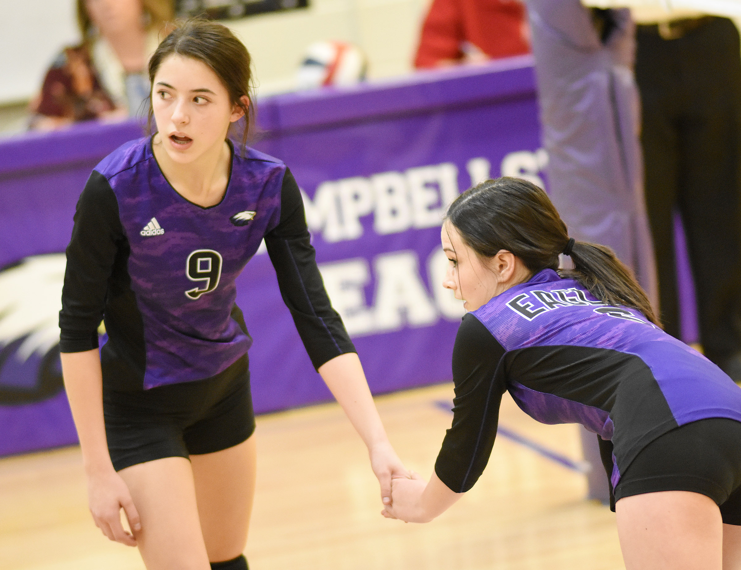 CMS eighth-graders Kaylyn Smith, at left, and Sarah Adkins get ready for the serve.