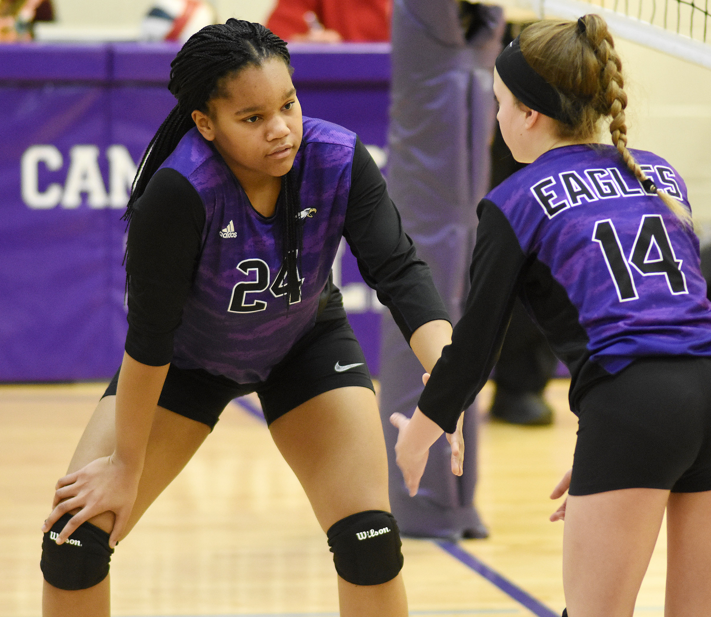 CMS seventh-grader Antaya Epps, at left, and Rylee Petett prepare for the serve.