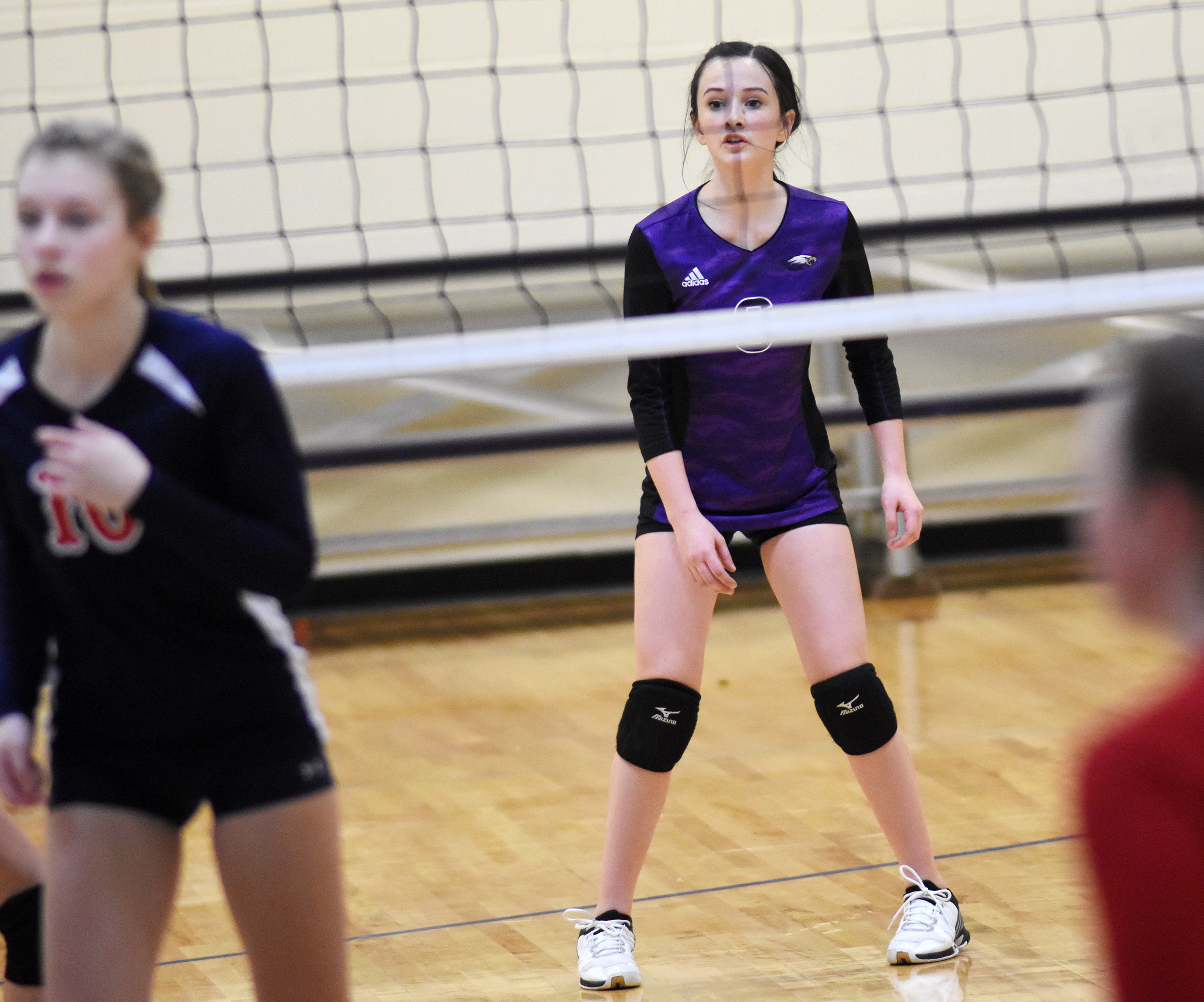 CMS eighth-grader Sarah Adkins watches the serve.