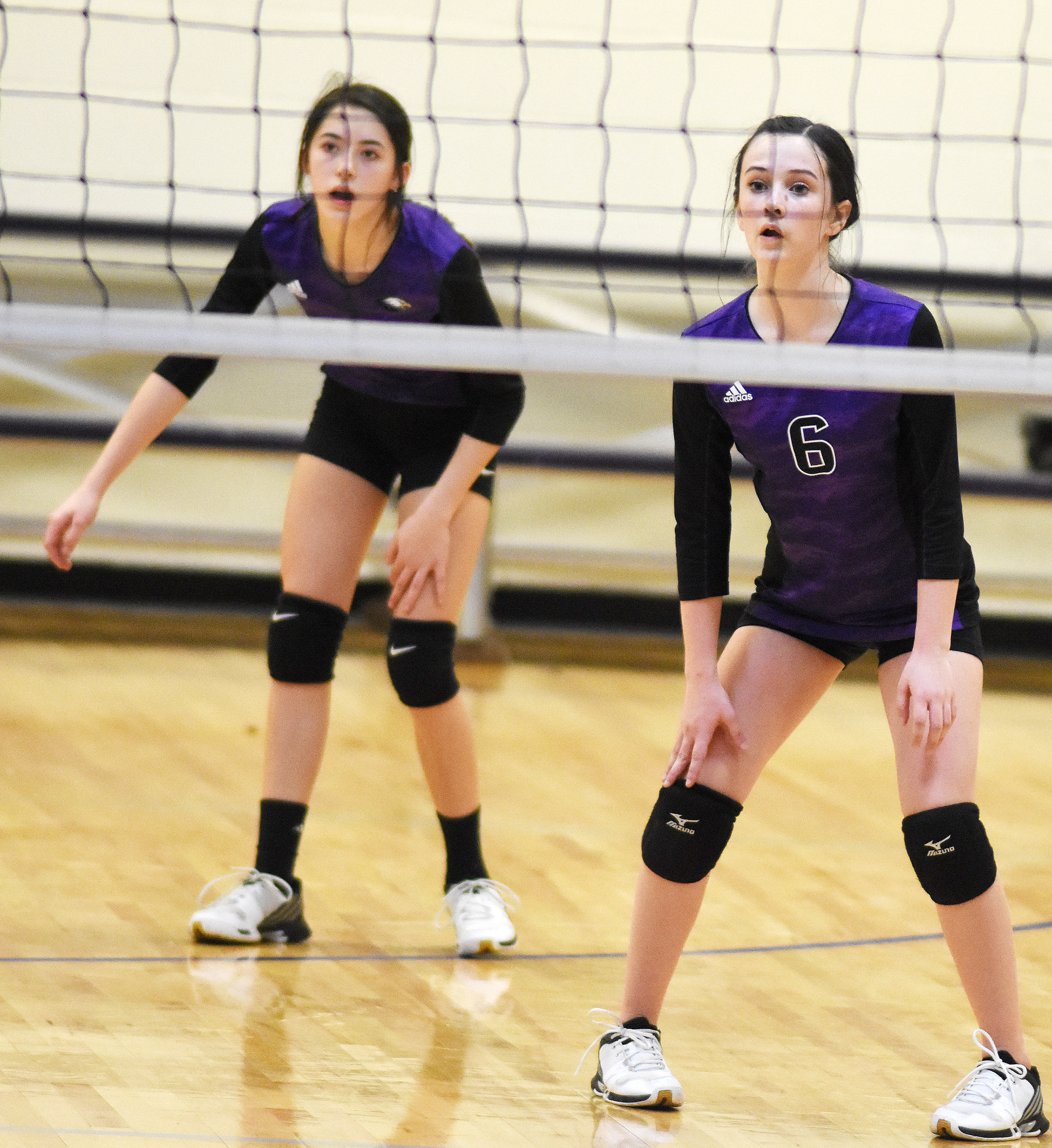 CMS eighth-graders Kaylyn Smith, at left, and Sarah Adkins watch the ball.