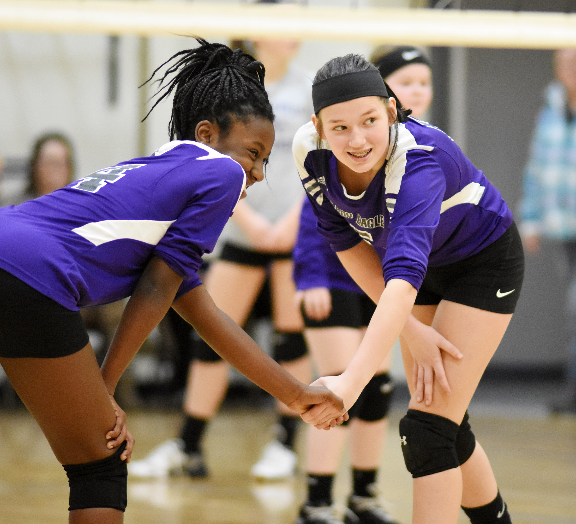 CMS eighth-grader Myricle Gholston, at left, and seventh-grader BreAnna Humphress get ready for the serve.