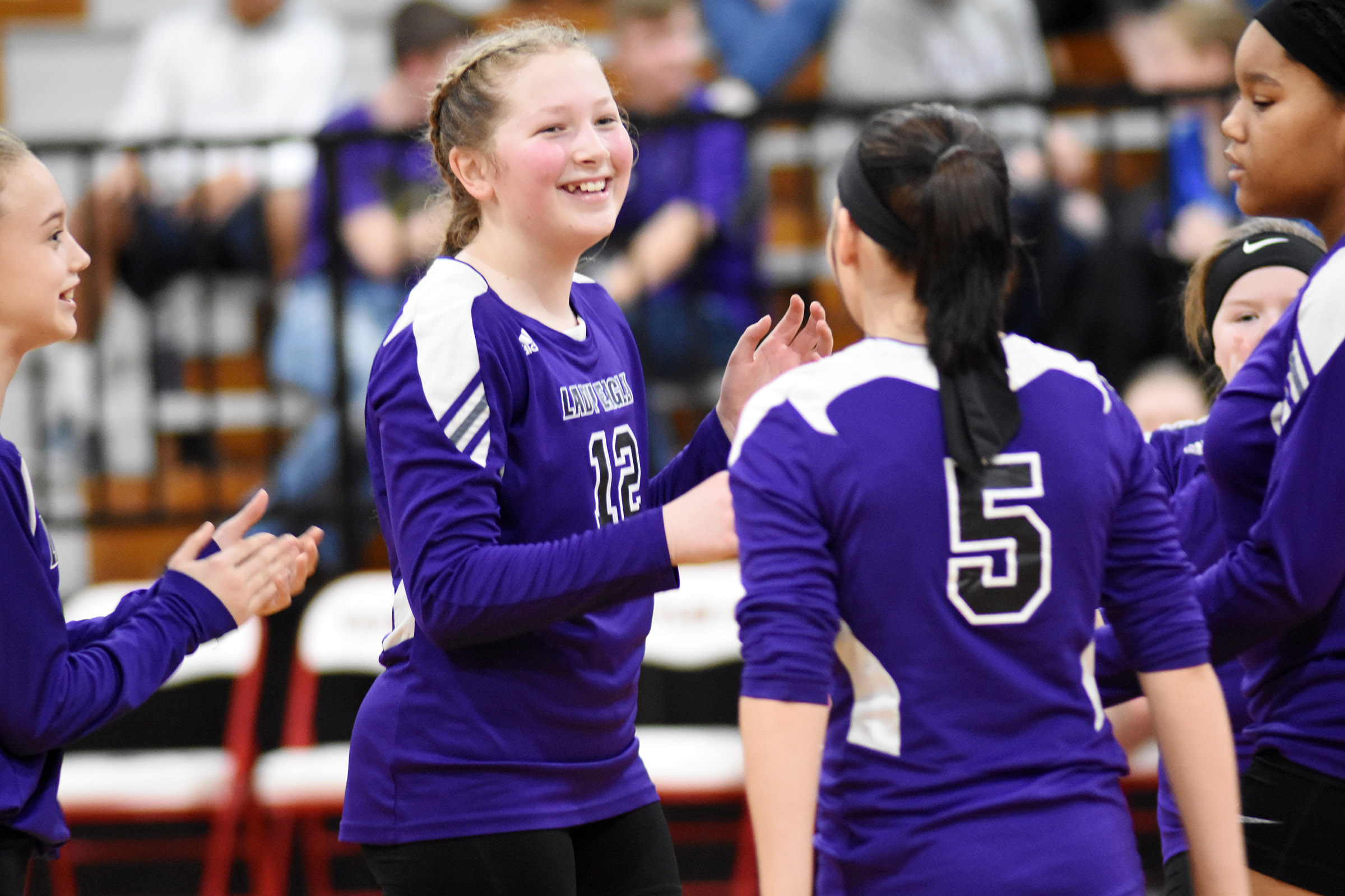 CMS sixth-grader Ava Hughes cheers with her classmates after a point.