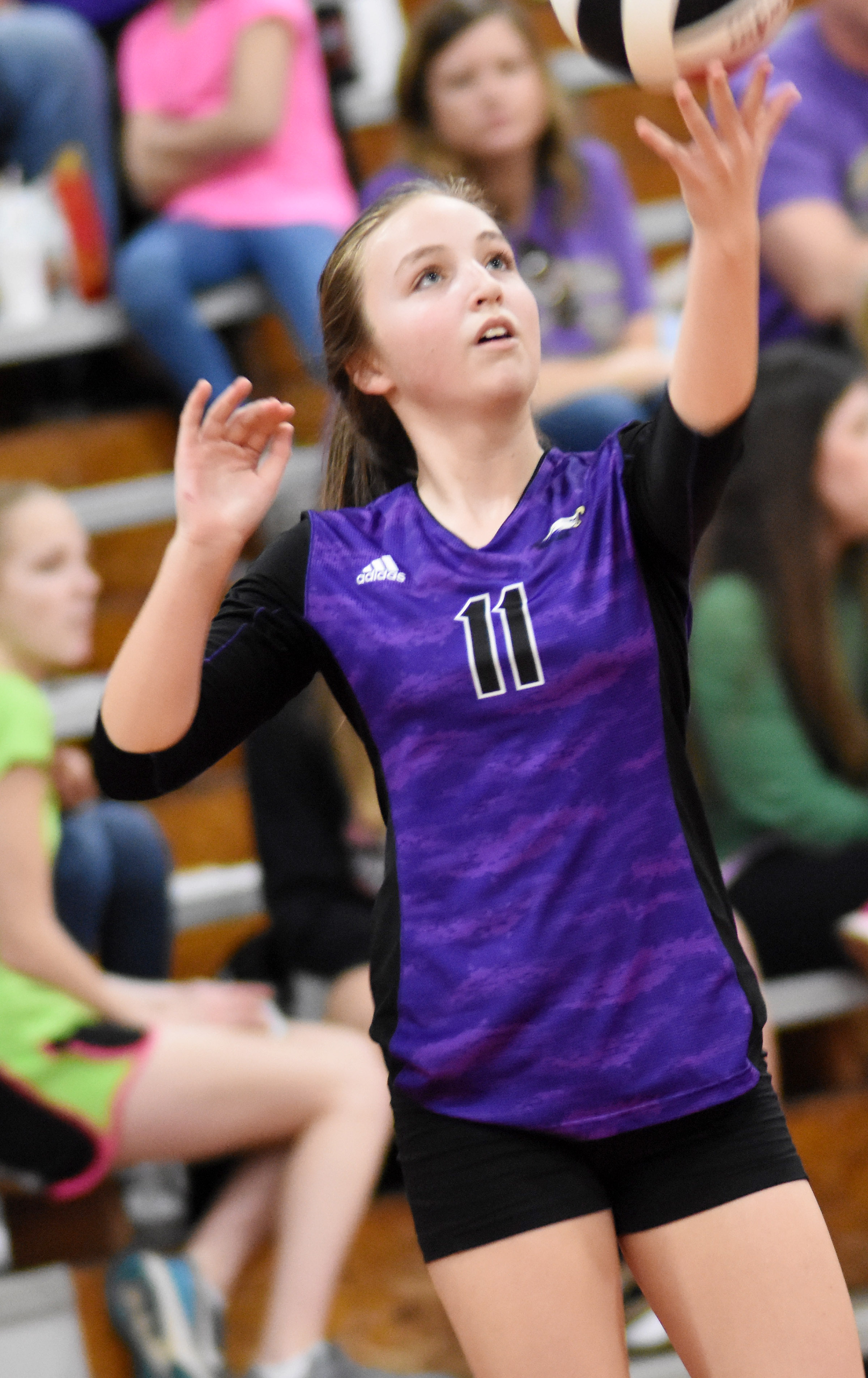 CMS eighth-grader Lainey Watson serves.