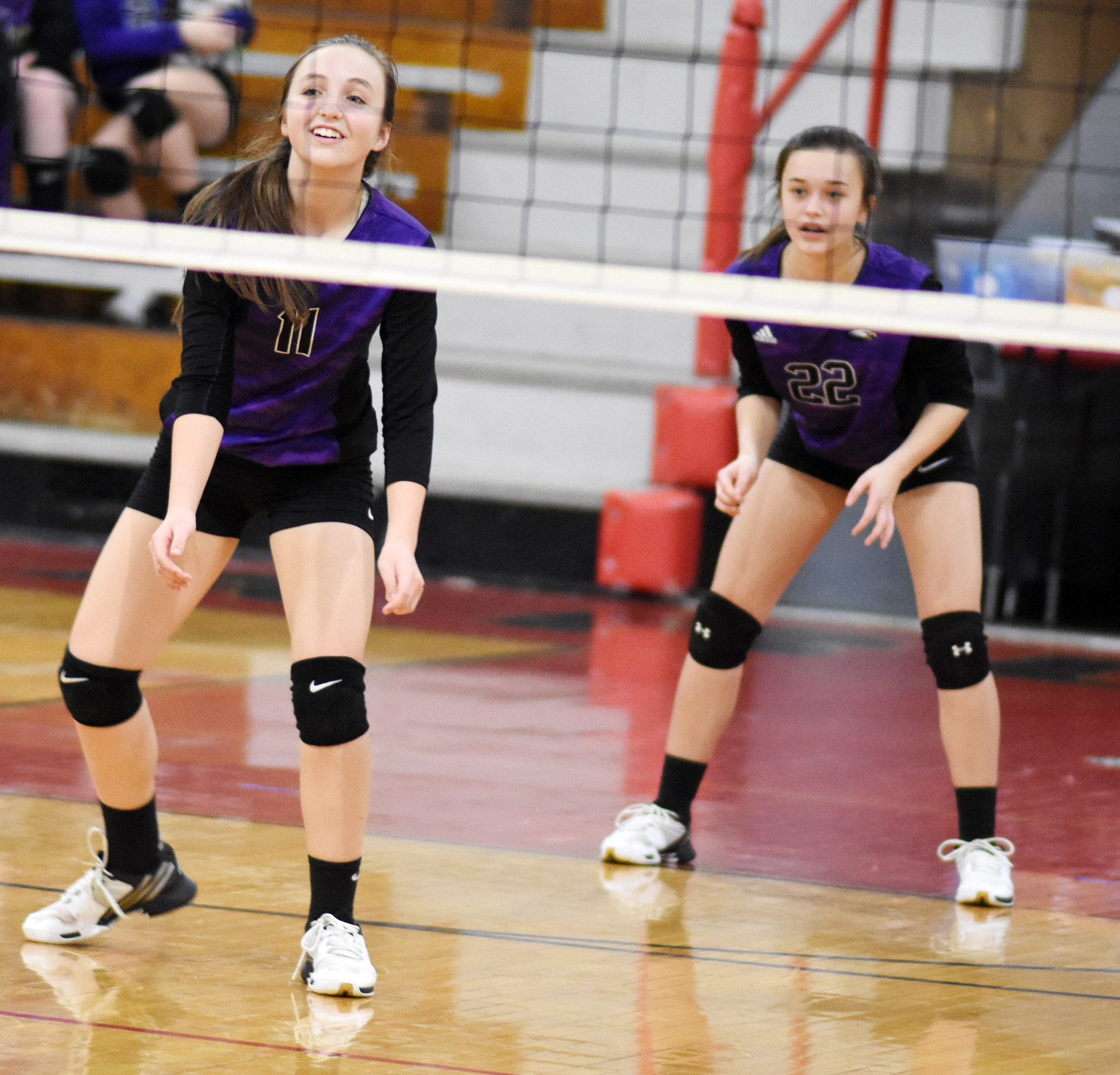 CMS eighth-graders Lainey Watson, at left, and Tayler Thompson watch the ball.