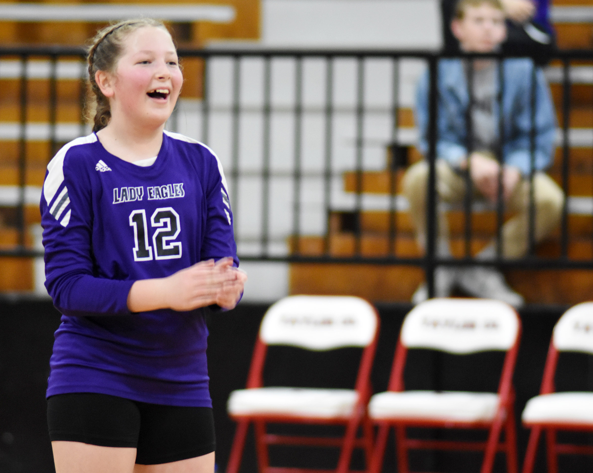 CMS sixth-grader Ava Hughes cheers after a point.