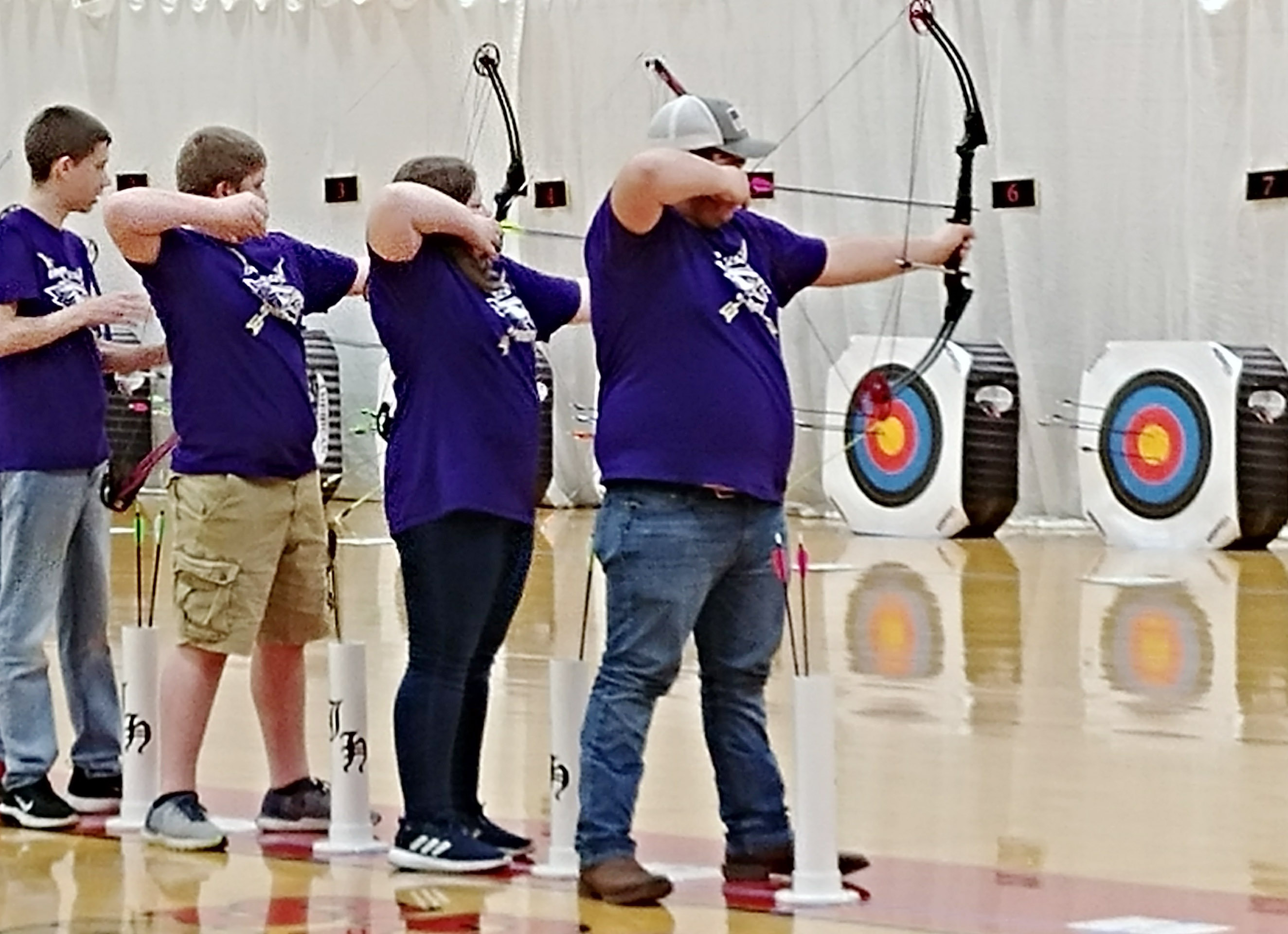 From left, CMS eighth-grader Blake Tungate, seventh-grader Lance Knifley, sixth-grader Kaylyn Lawson and CHS freshman Isaac Underwood shoot.