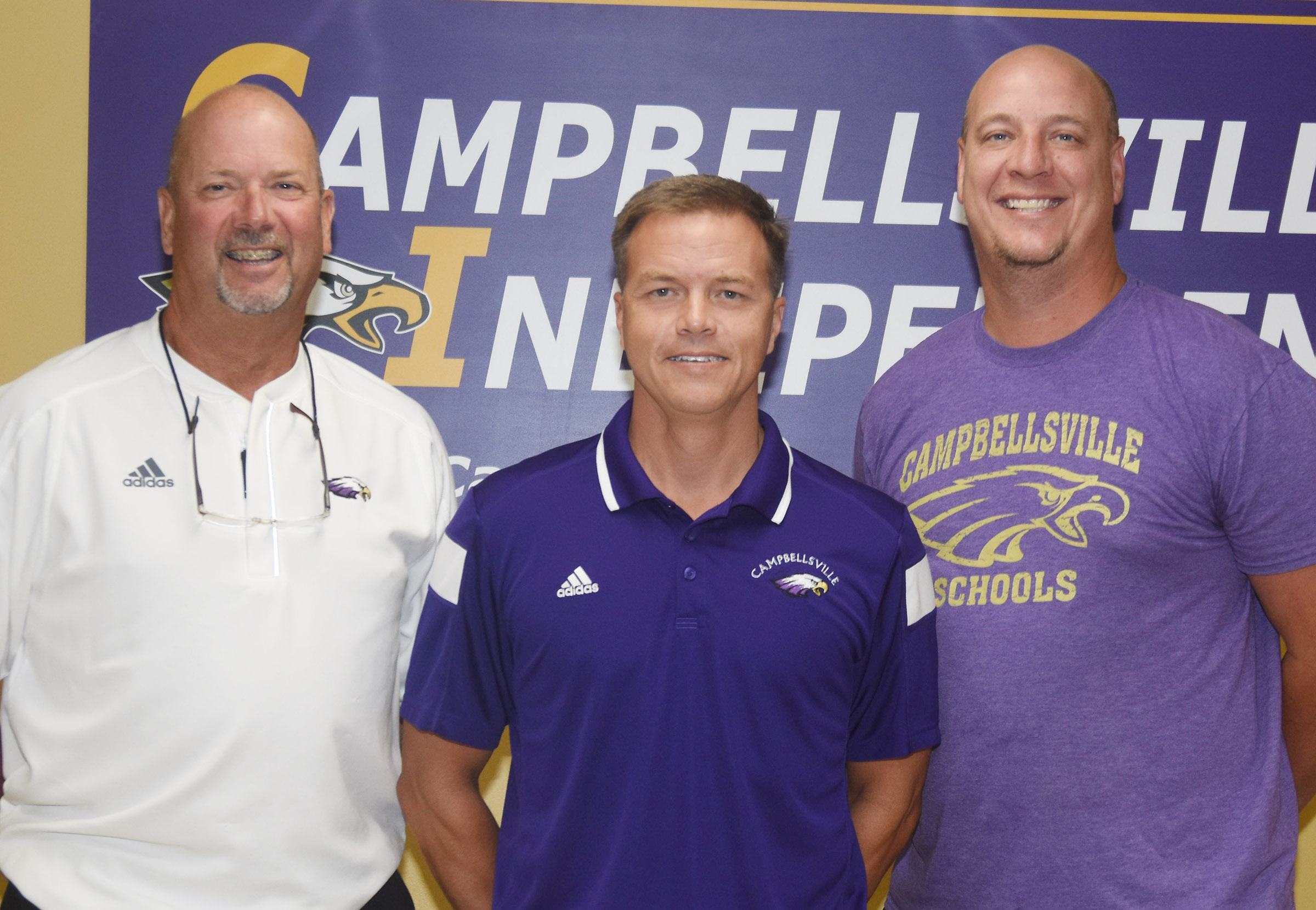 Chris Kidwell, who serves as associate superintendent and finance director at Campbellsville Independent Schools, will lead the Campbellsville High School archery team. Pictured with him are CHS Athletic Director Tim Davis, at left, and CHS Principal David Petett.