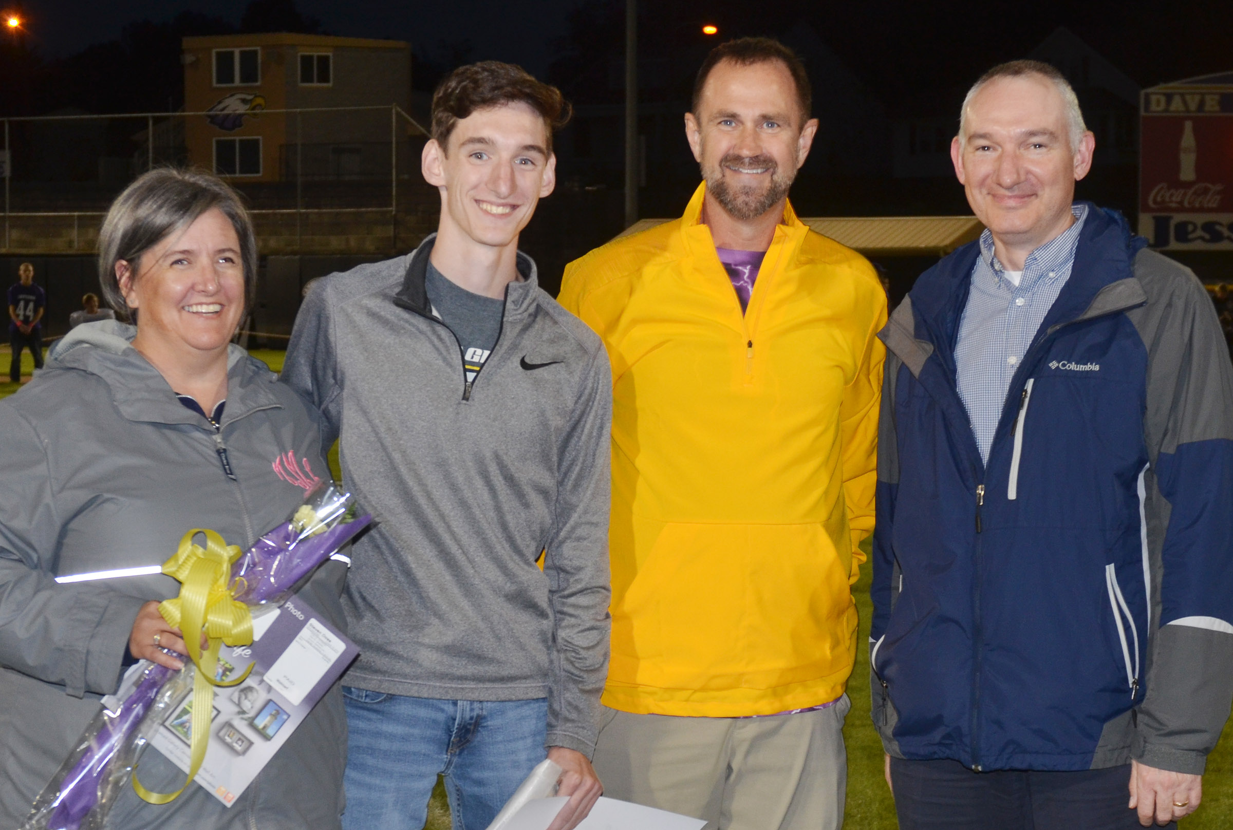 CHS senior cross country runner Ian McAninch was honored on Friday, Oct. 19. He is pictured with his mother Lori, at left, father Troy, at right, and coach Steve Doss.