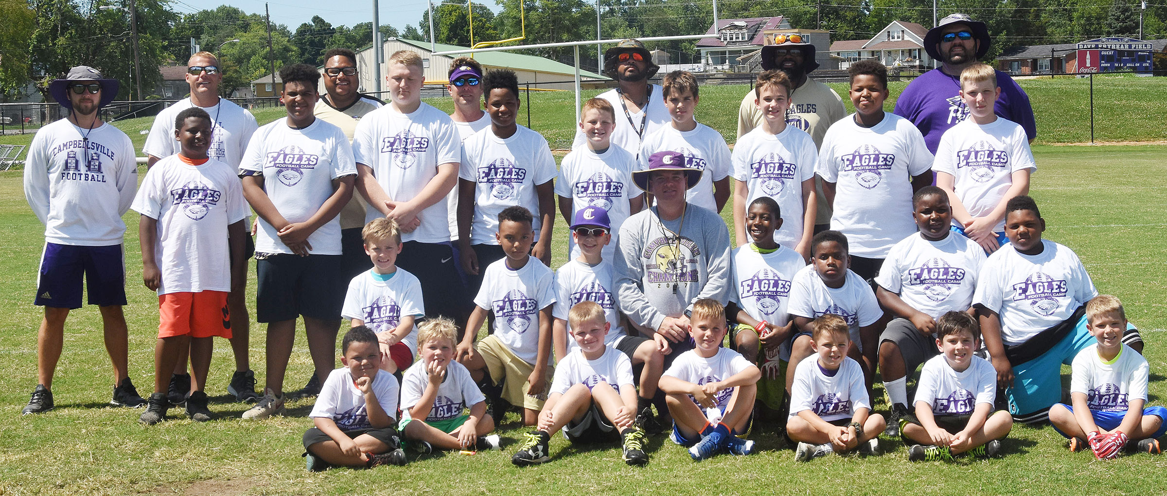 Campbellsville middle and high school football coaches hosted a youth camp recently, with about 25 participants. From left, front, are Campbellsville Elementary School first-graders Kingson Duncan and Landry Brown, Griff Thomas, Owen Smith, CES first-grader Hayden Goff, Trey Moore and Blake Absher. Second row, Campbellsville Elementary School fifth-grader Braydn Spurling, fourth-grader Maddox Hawkins, CHS head football coach Dale Estes, CES fourth-graders Jaron Johnson and Elijah Spurling, Julian Smith and CES fifth-grader Malikiah Spurling. Third row, Campbellsville Middle School sixth-grader KeKe Miller, eighth-graders J.T. Washington, Levi Dicken and Deondre Weathers, seventh-graders Junior Jeffries and Kaden Bloyd, eighth-graders Camren Vicari and Keondre Weathers and sixth-grader Kaleb Miller. Back, CHS assistant football coaches Tyler Hardy, Robbie Gribbins, Bronson Gowdy, Herb Wiseman, Aaron Webb, Will Griffin and D.J. Moore.