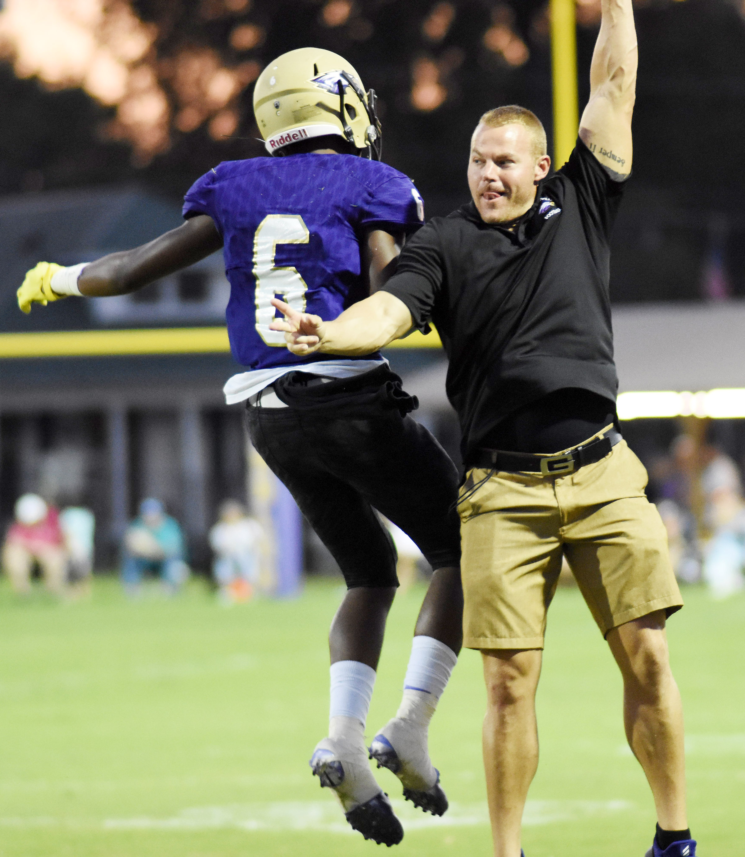 CHS junior Malachi Corley celebrates a touchdown with assistant coach Robbie Gribbins.